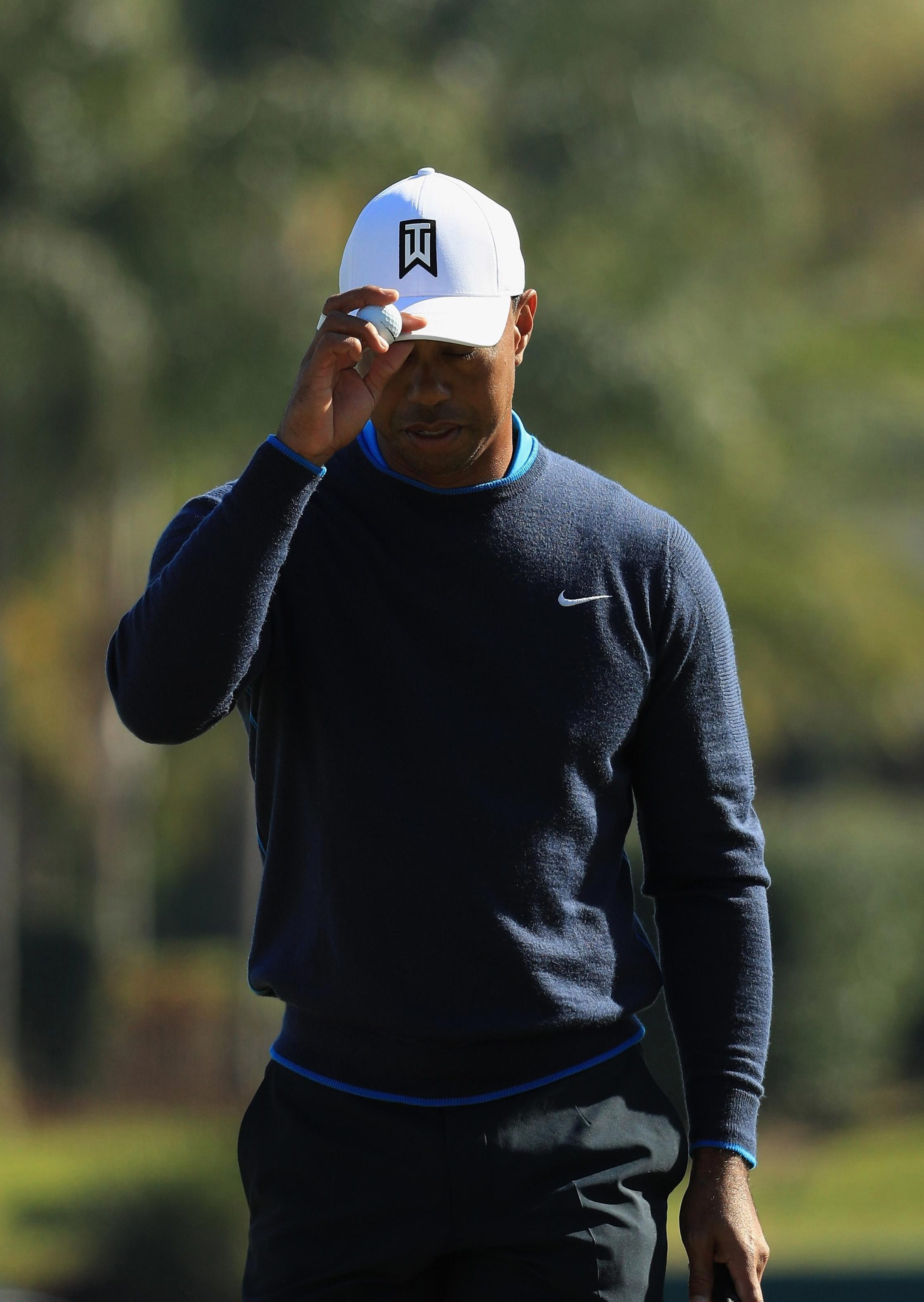 Tiger Woods fumed after seeing a rogue shot creep under a fence