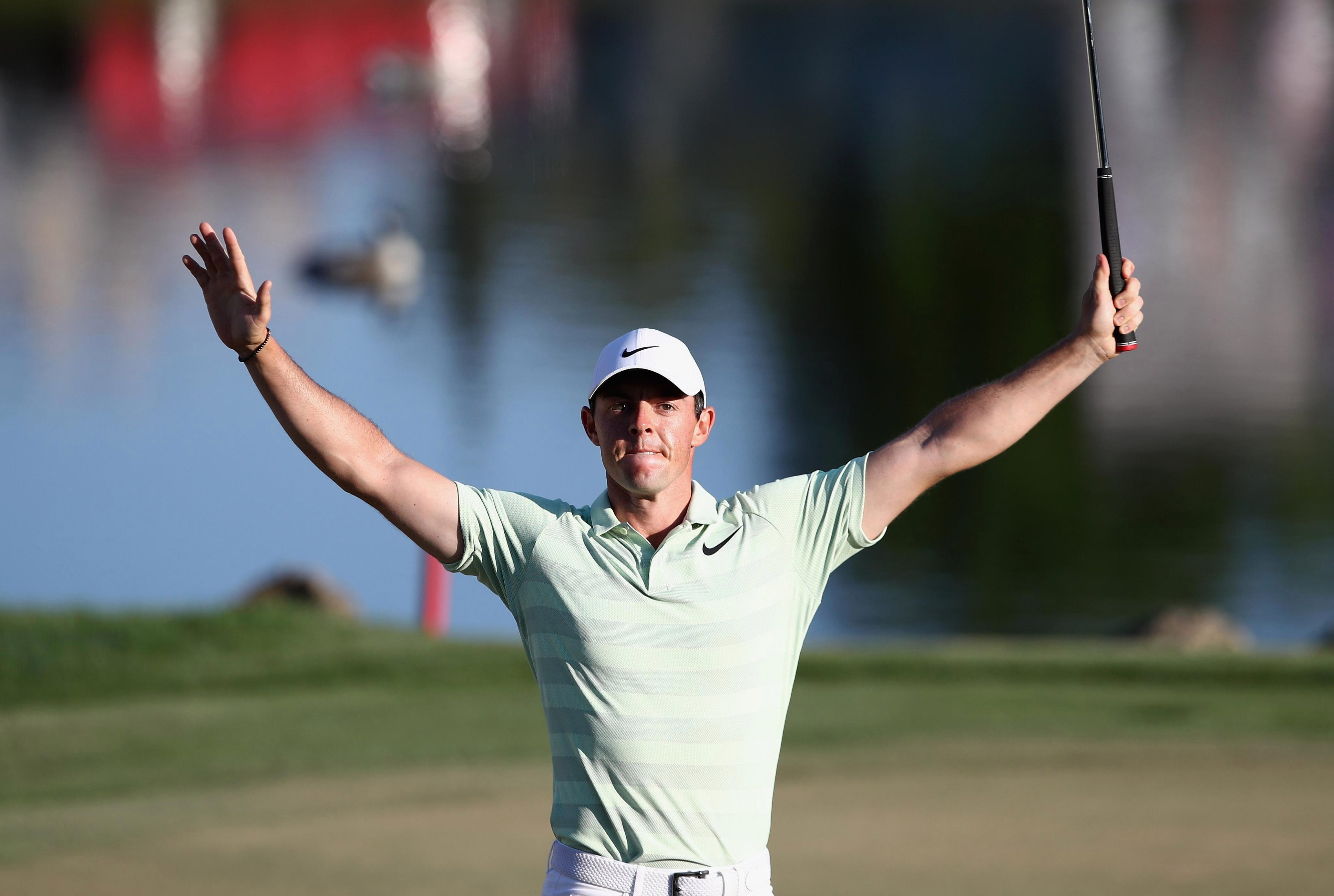 McIlroy reacts after putting a huge 25 foot putt on the 18th hole