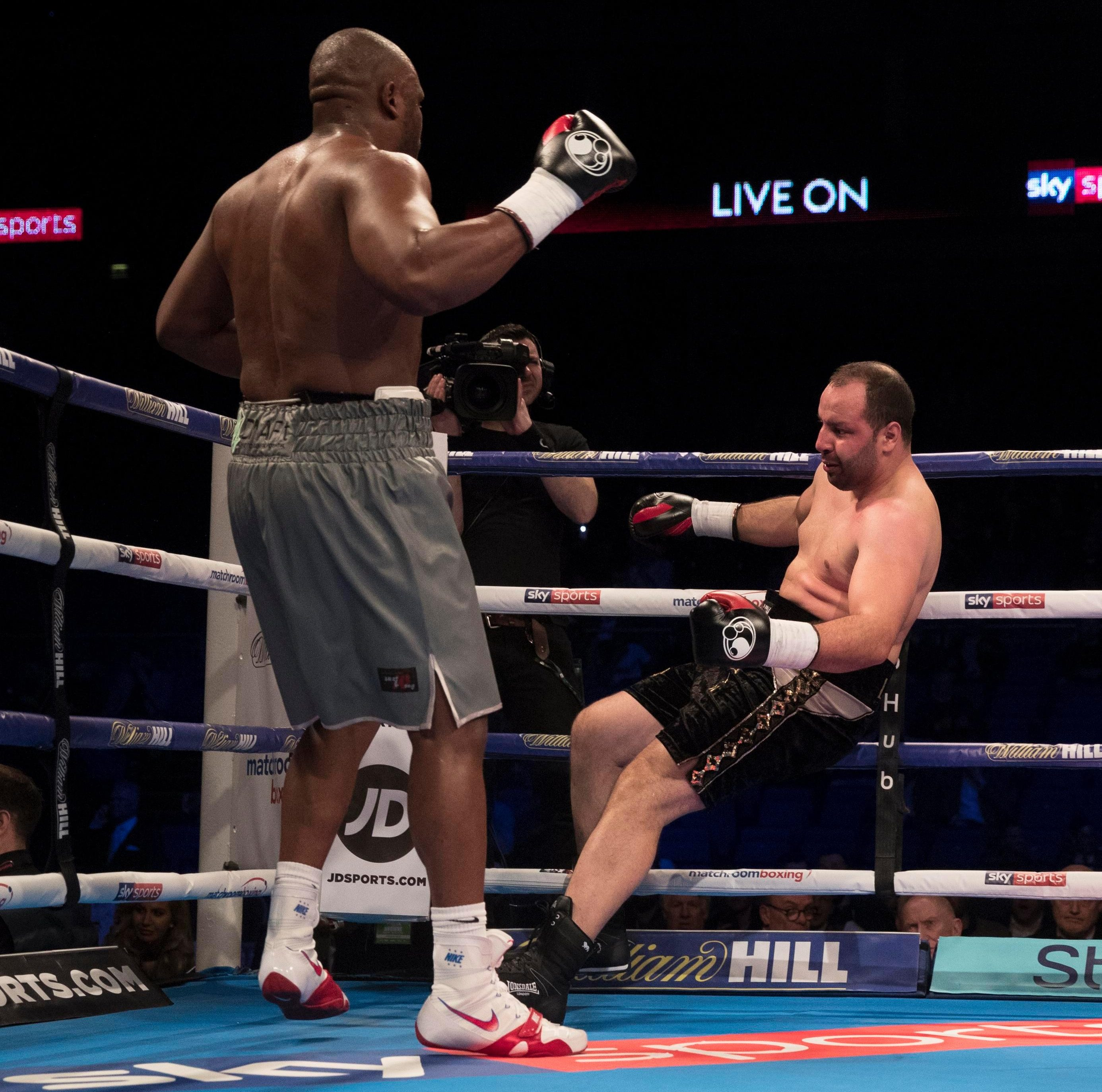 Dereck Chisora sends Zakaria Azzouzi crashing to the canvas