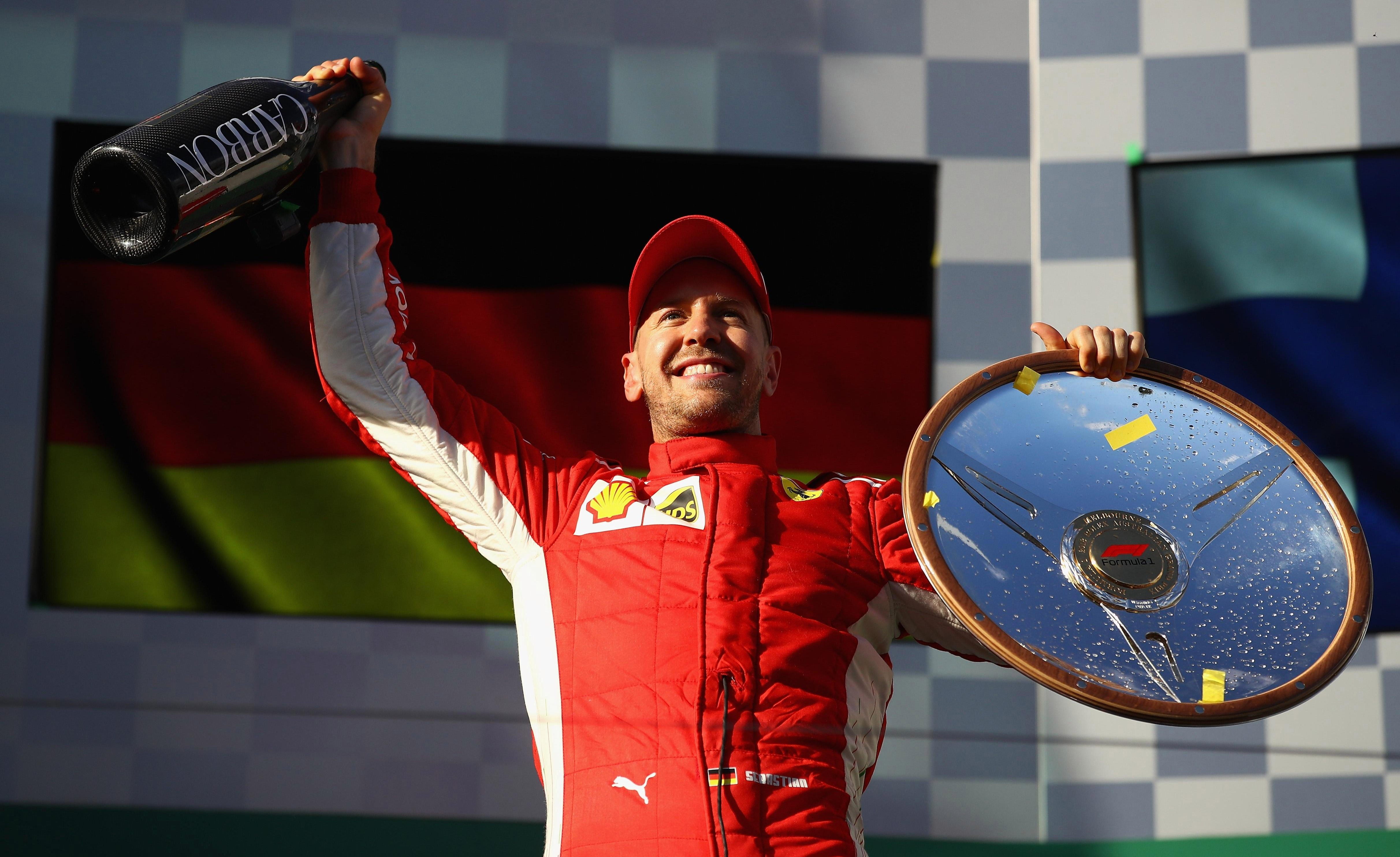Sebastian Vettel celebrates 48th victory of his career, after finishing first in Melbourne