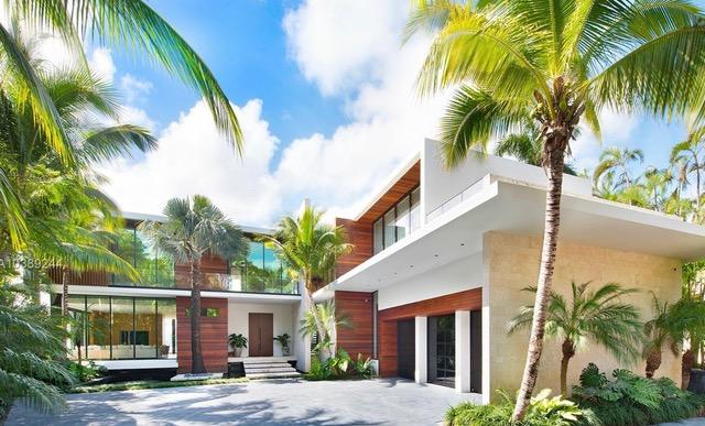 The contemporary design is straight-lined and various palm trees are planted around the entrance area