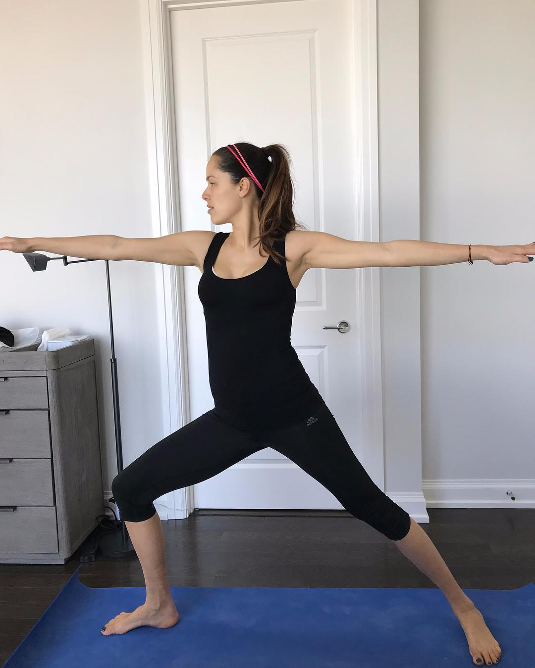 Ivanovic looks fighting fit as she works out on a yoga mat