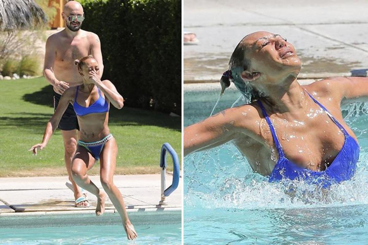 Mel B Suffers A Wardrobe Malfunction As She Leaps Into A Swimming