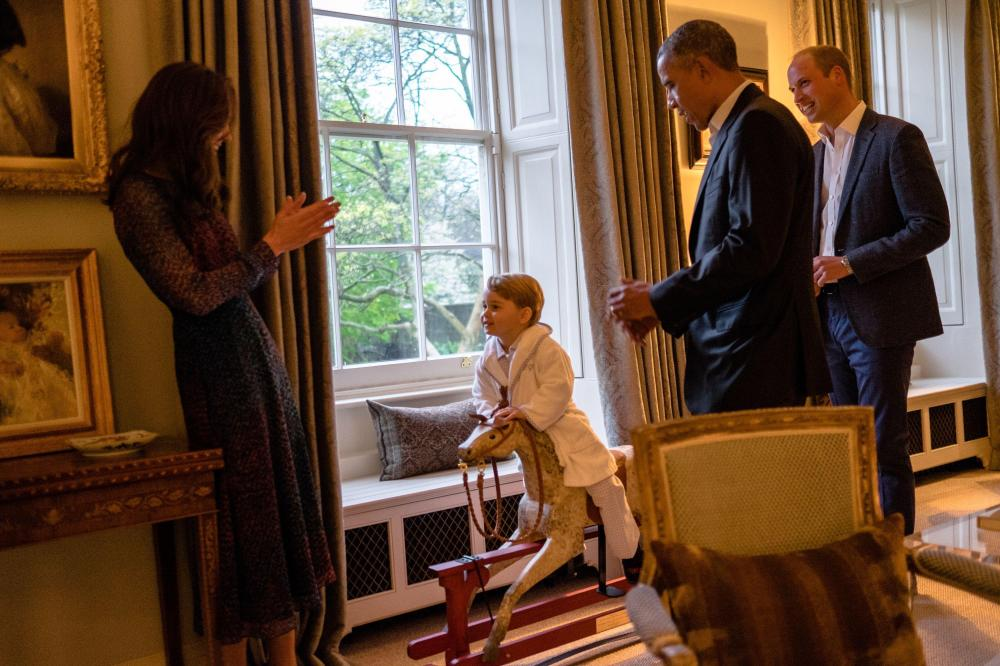 Prince George was the centre of attention when family entertained Barack Obama at their Kensington home