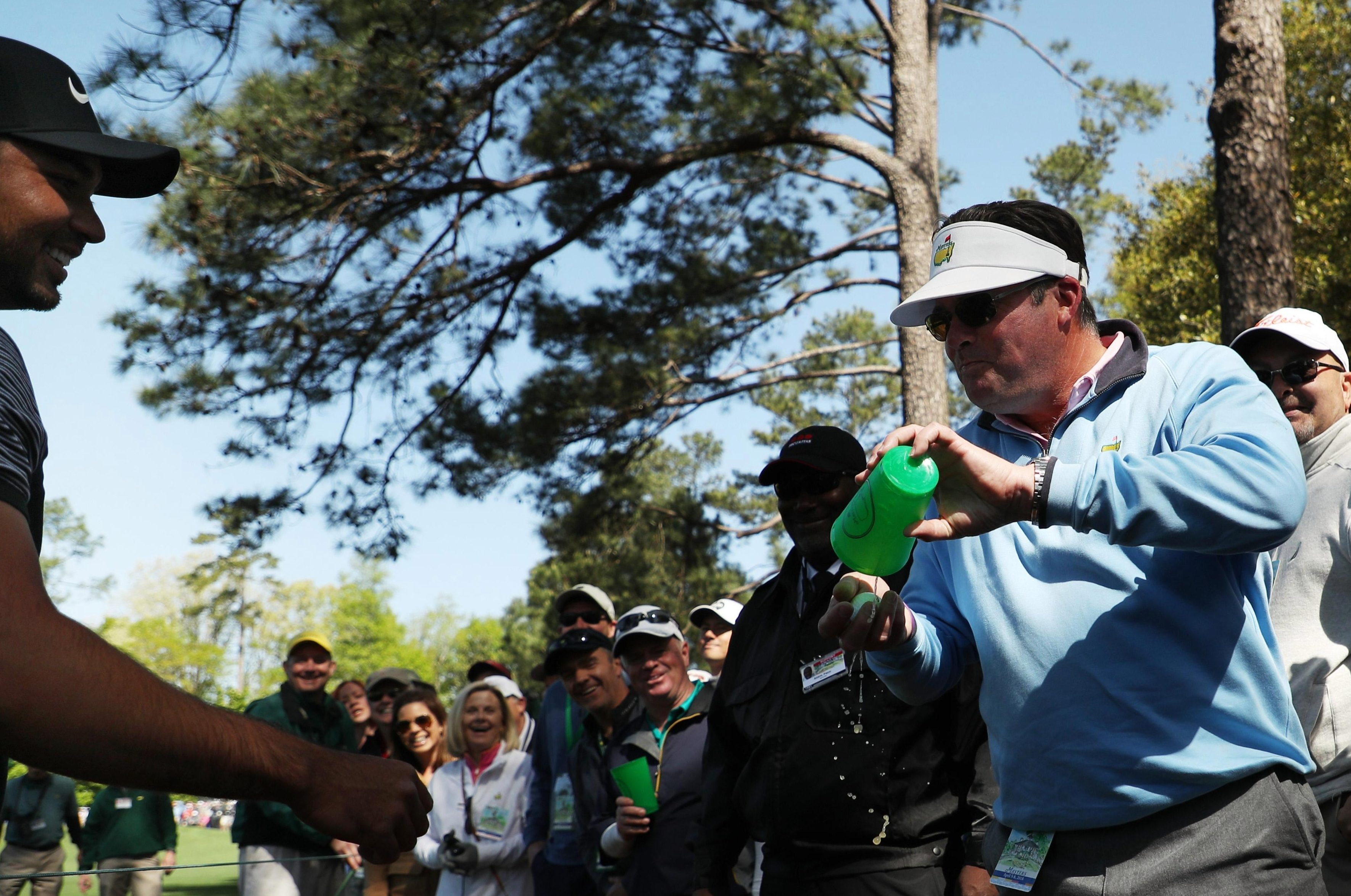 The patron shows Jason Day his cup is empty