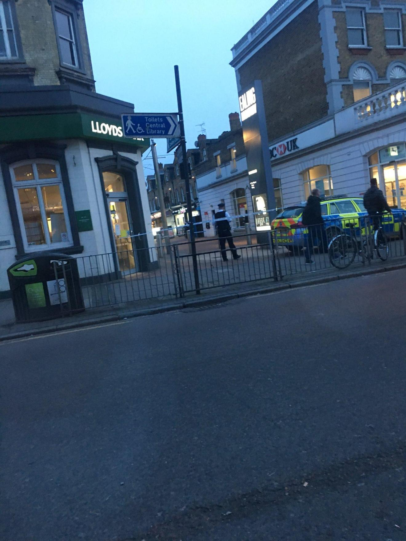 Police at the scene of the attack in Ealing Broadway where a man in his late teens was stabbed
