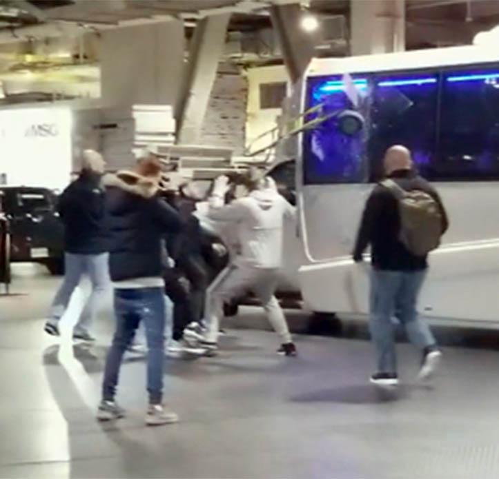 Conor McGregor smashes a bus window during bust up with rival fighter Khabib Nurmagomedov