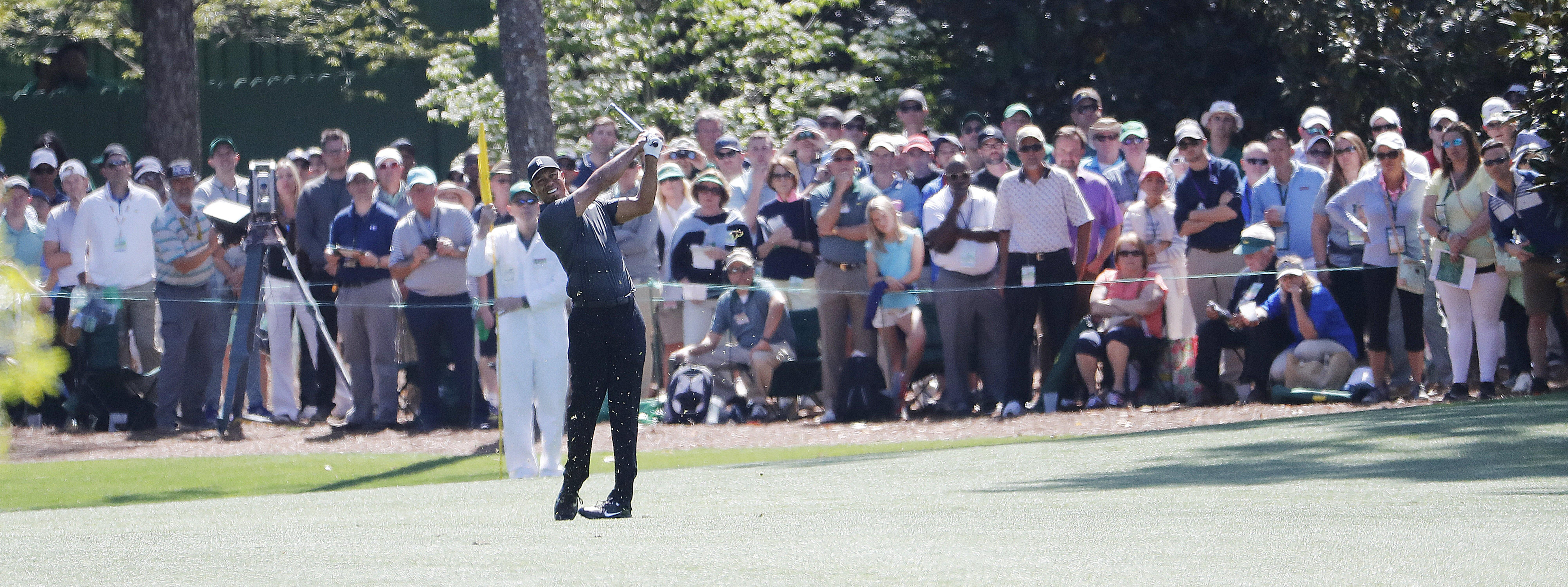 Tiger Woods was pleased with his scrambling on a day when he sprayed his ball into the spectators