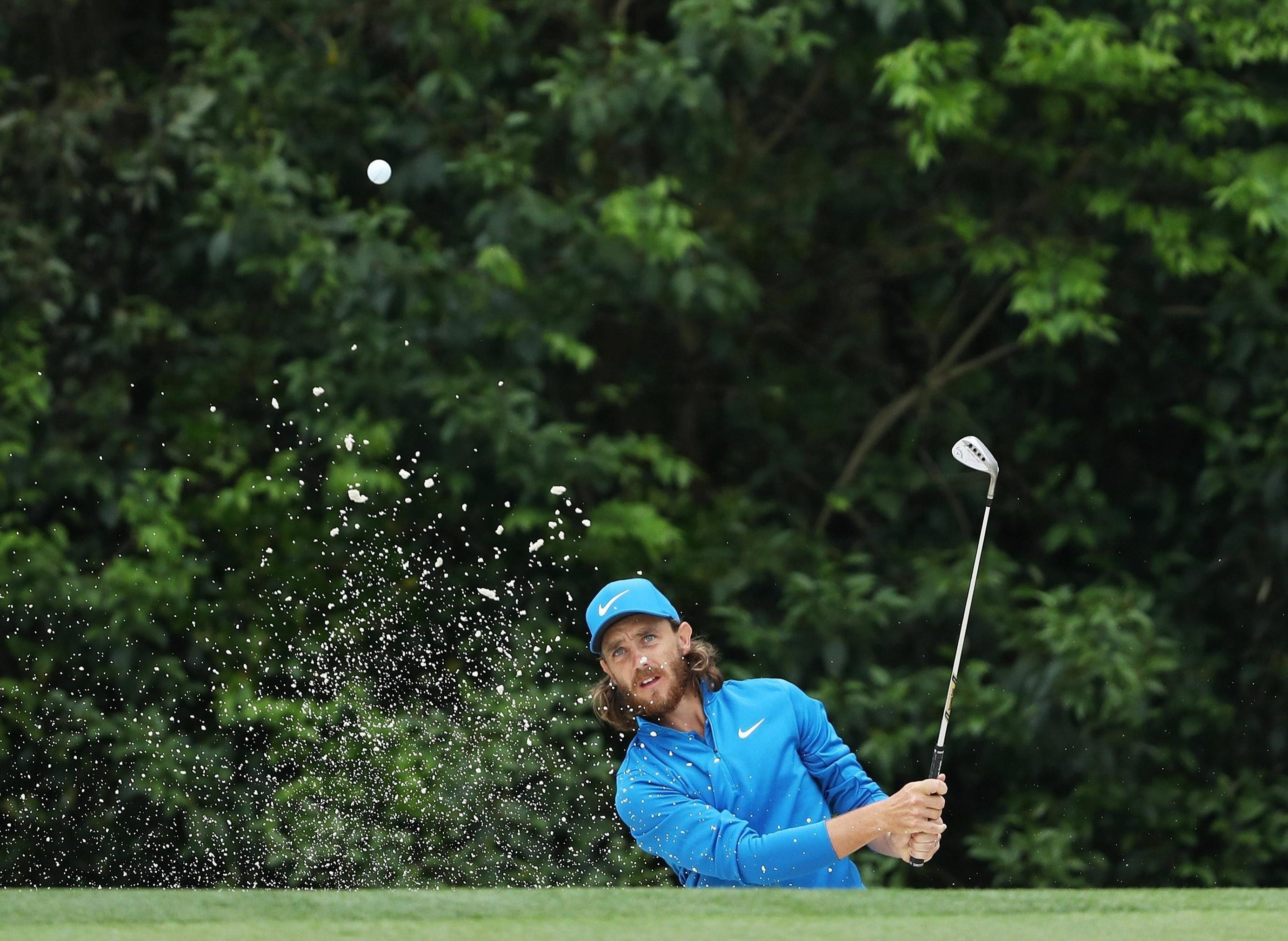 Fleetwood plays a chip shot on the par-four 5th hole at Augusta