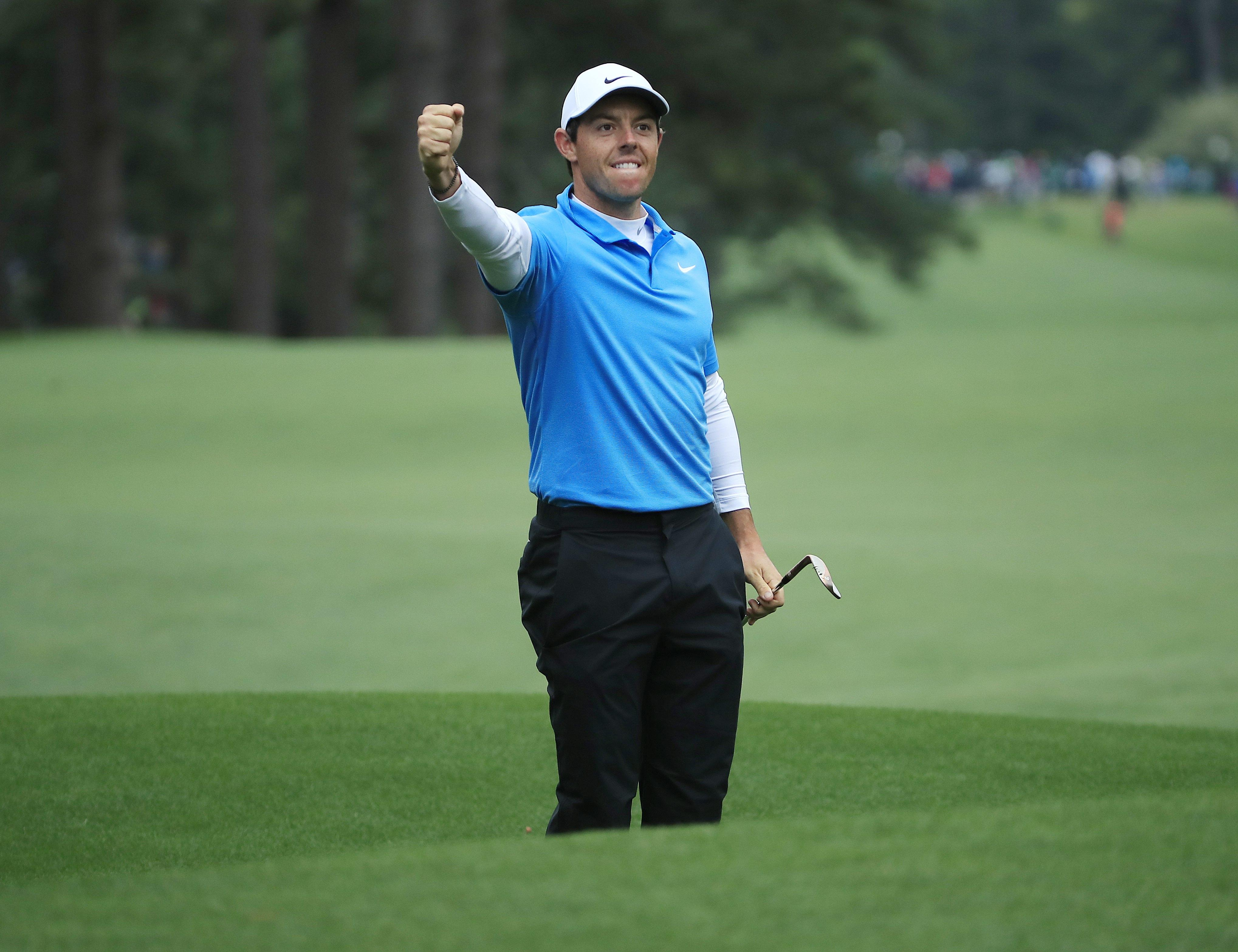 Rory mcIlroy fist pumps after a stunning eagle on the 8th hole during the third round of the Masters