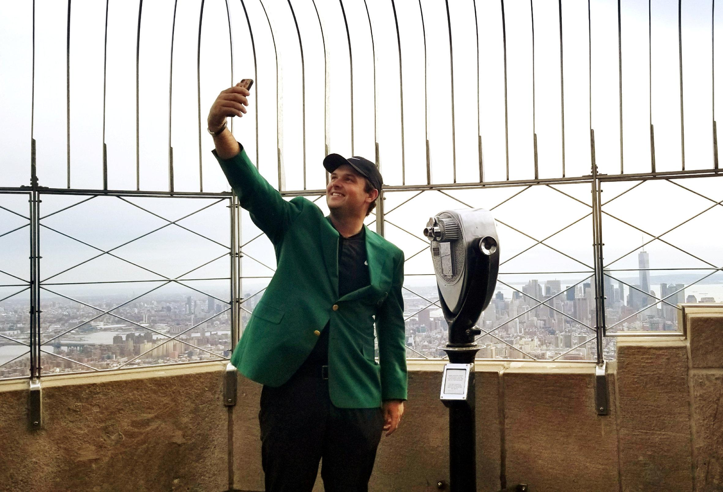 Earlier in the day, Patrick Reed visiting the Empire State Building