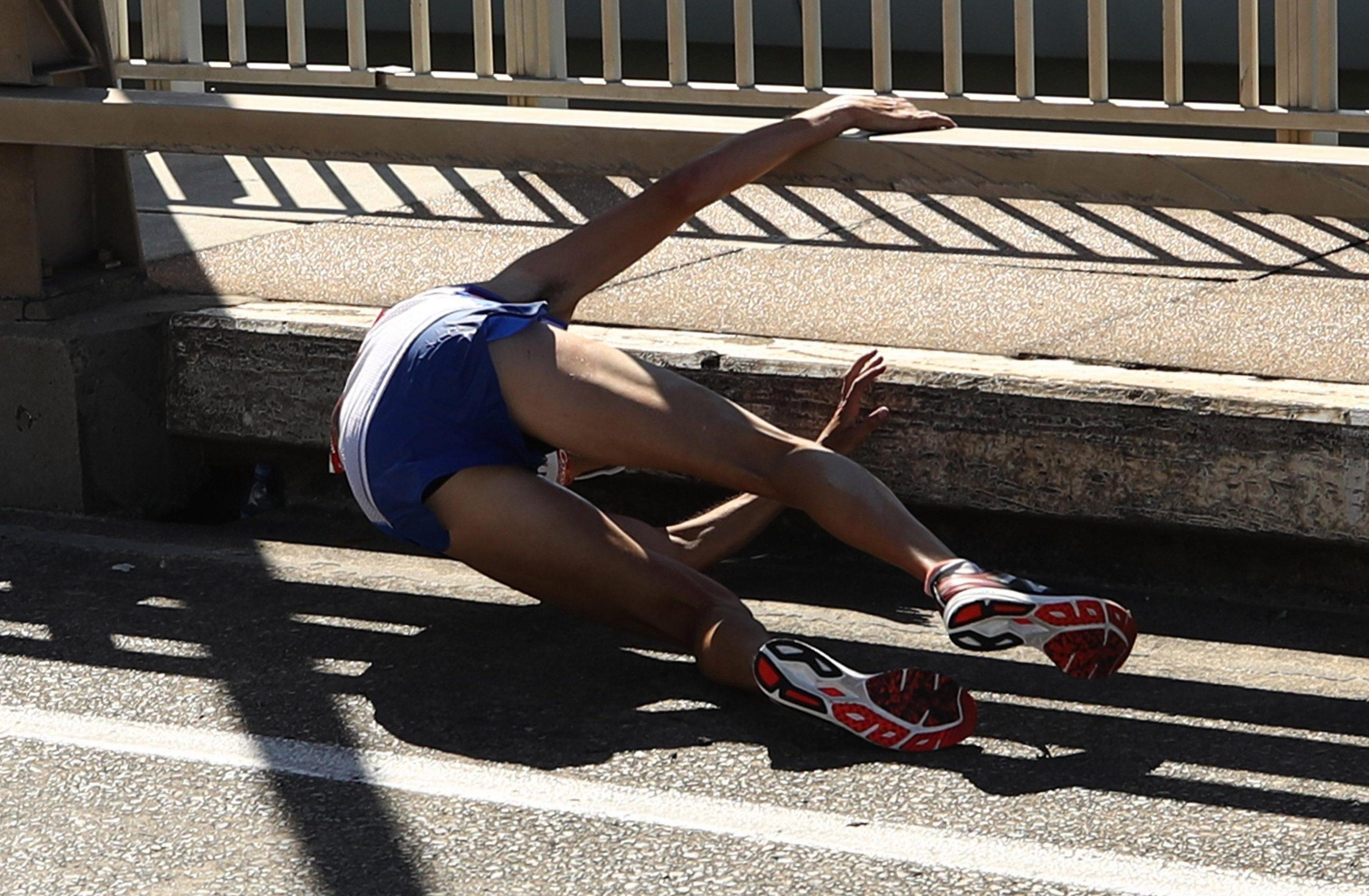 Scottish athlete Callum Hawkins tumbles over during marathon