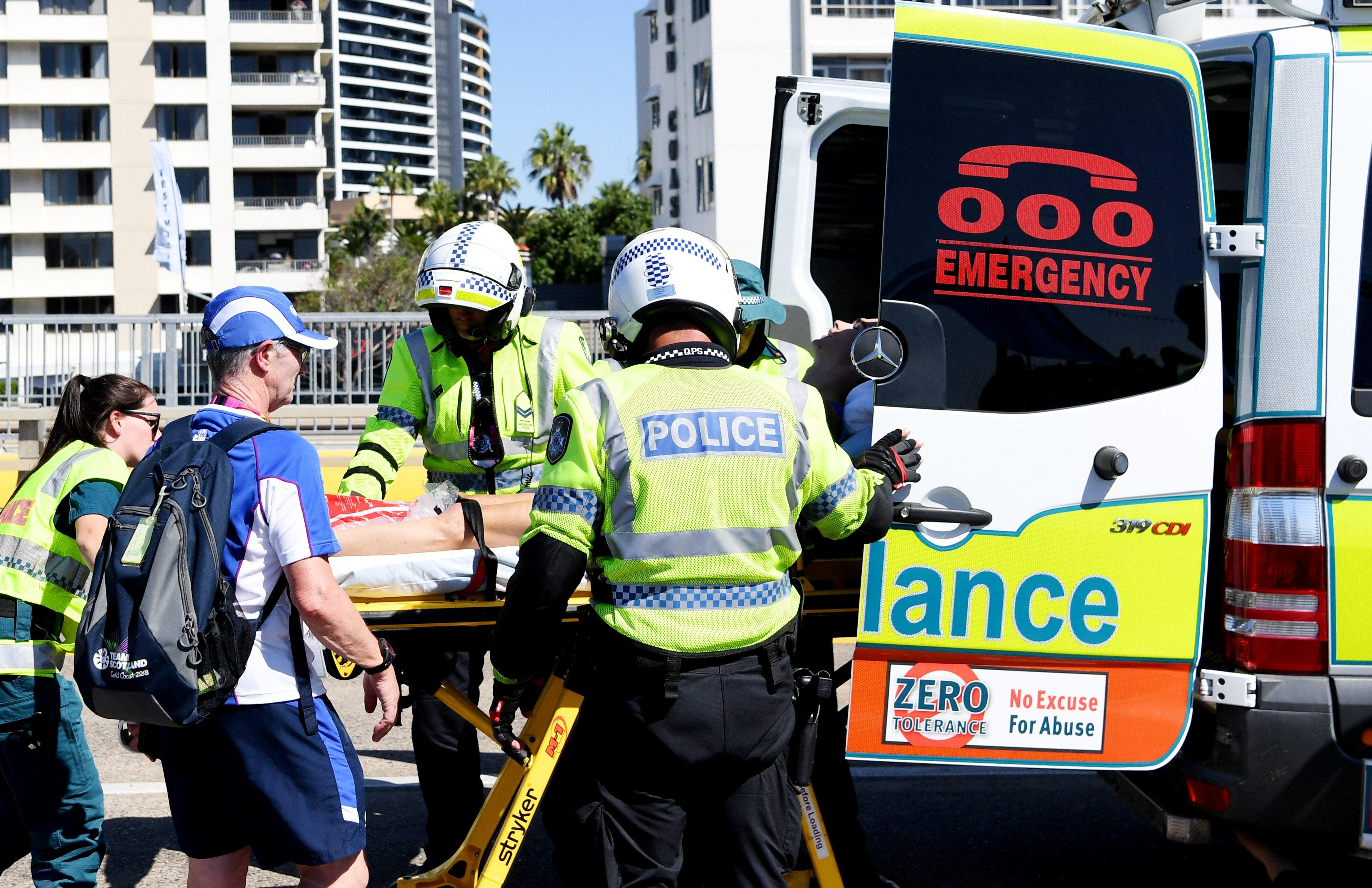Callum Hawkins is taken to hospital in an ambulance after his marathon collapse