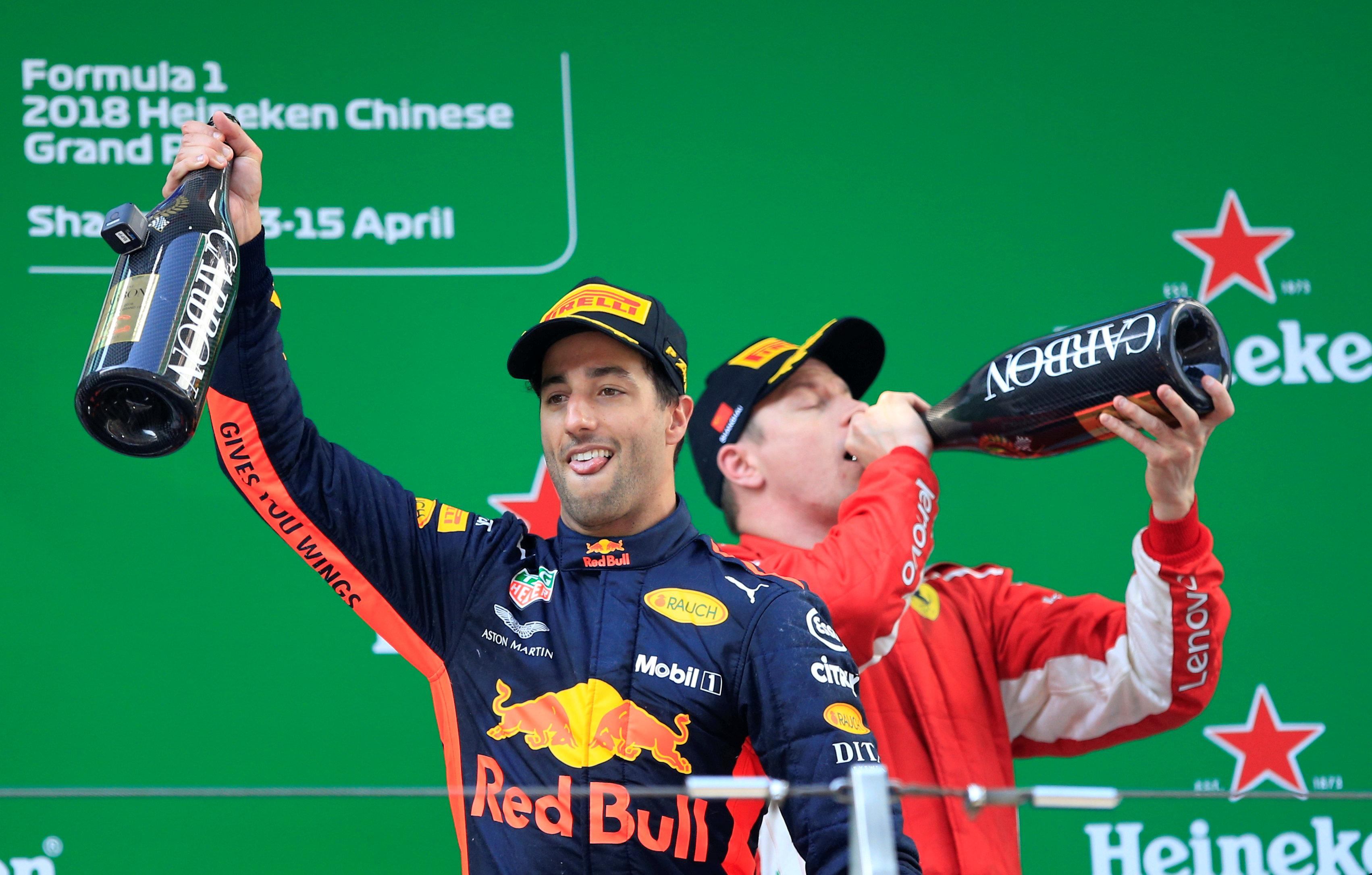 Daniel Ricciardo with Kimi Raikkonen celebrate finishing on podium in Shanghai
