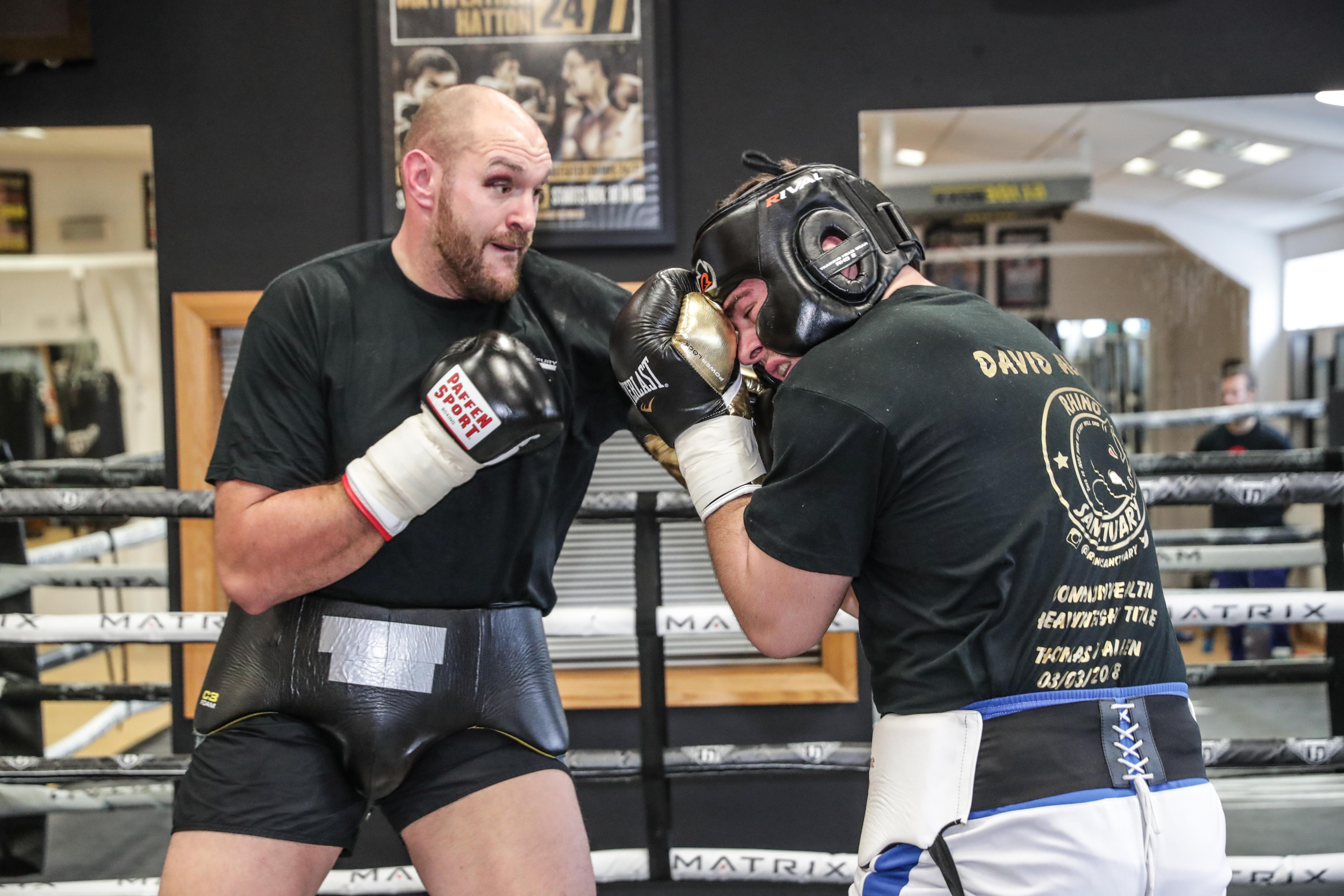 Tyson Fury has had some tough sessions in the ring sparring with David Allen, getting a black eye in the process