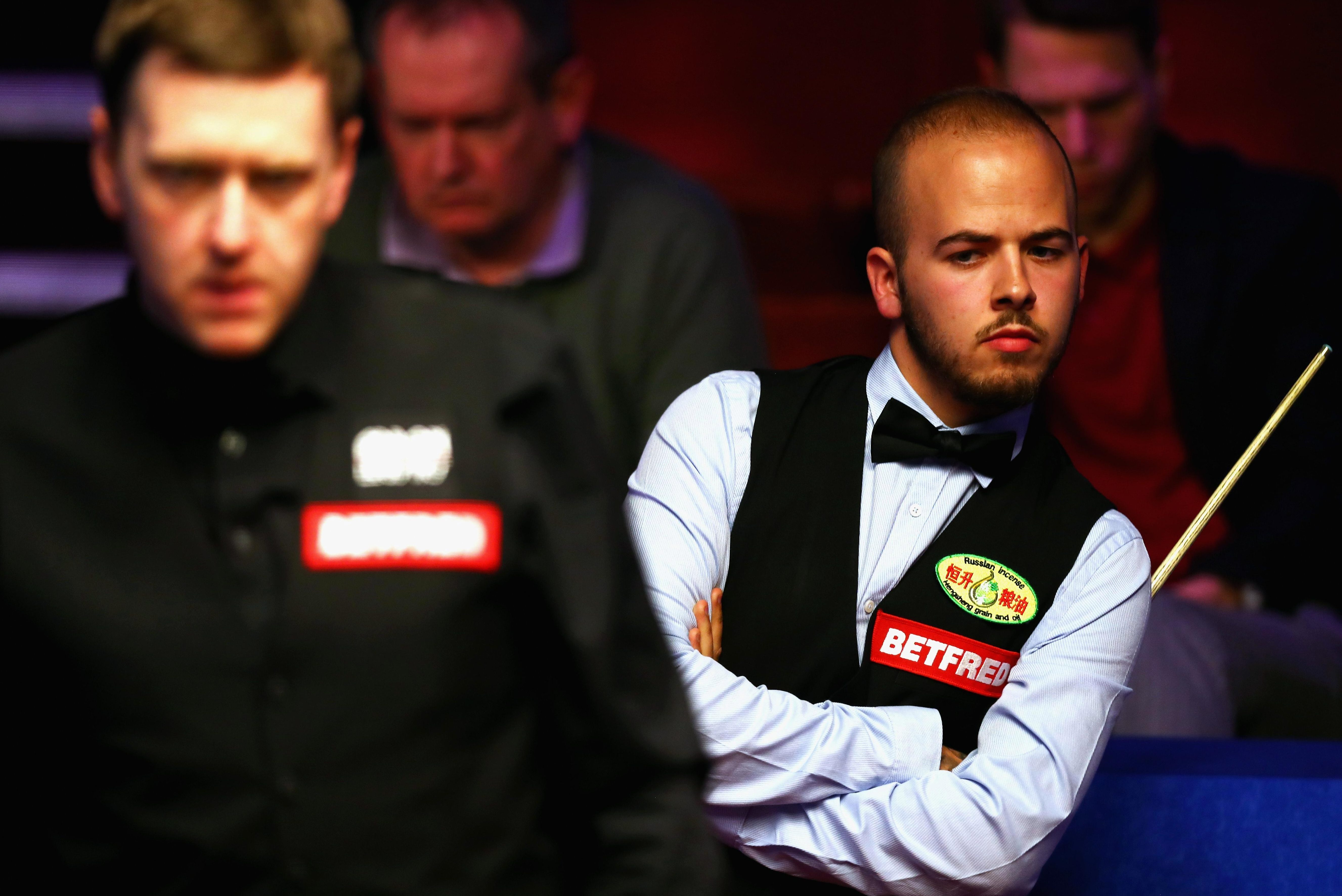 Belgium star Luca Brecel looks on as he takes on England ace Ricky Walden