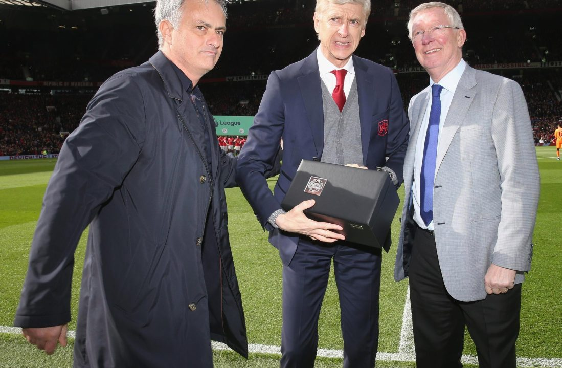 Arseen Wenger picks up a vase and warm words from old rivals Jose Mourinho and Alex Ferguson