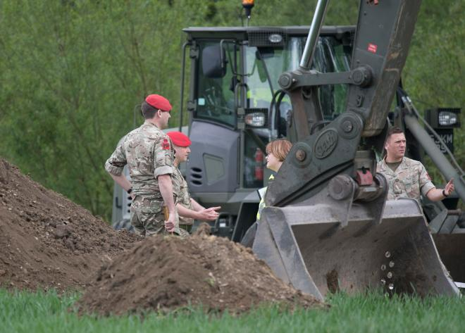 A digger was snapped removing soil where tot Katrice disappeared more than 30 years ago