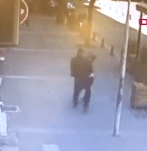 Moments earlier, the man is seen beating his ex-wife in the street