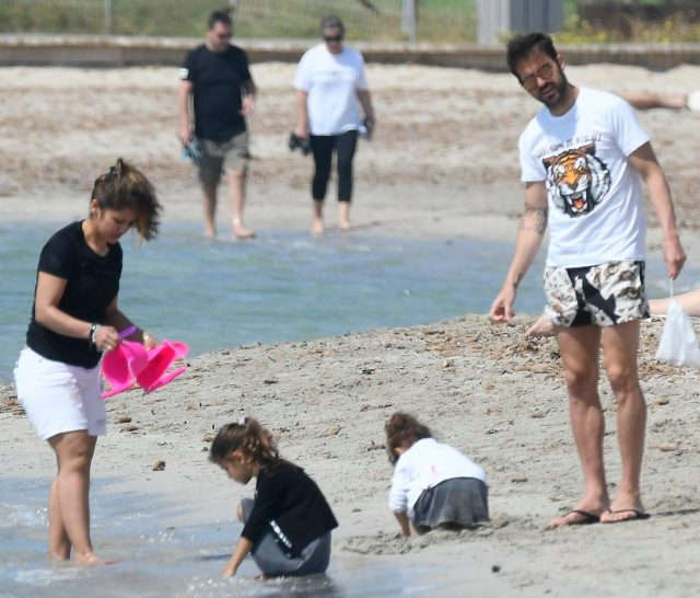 The couple and their kids got in the holiday mood by building sandcastles on the beach