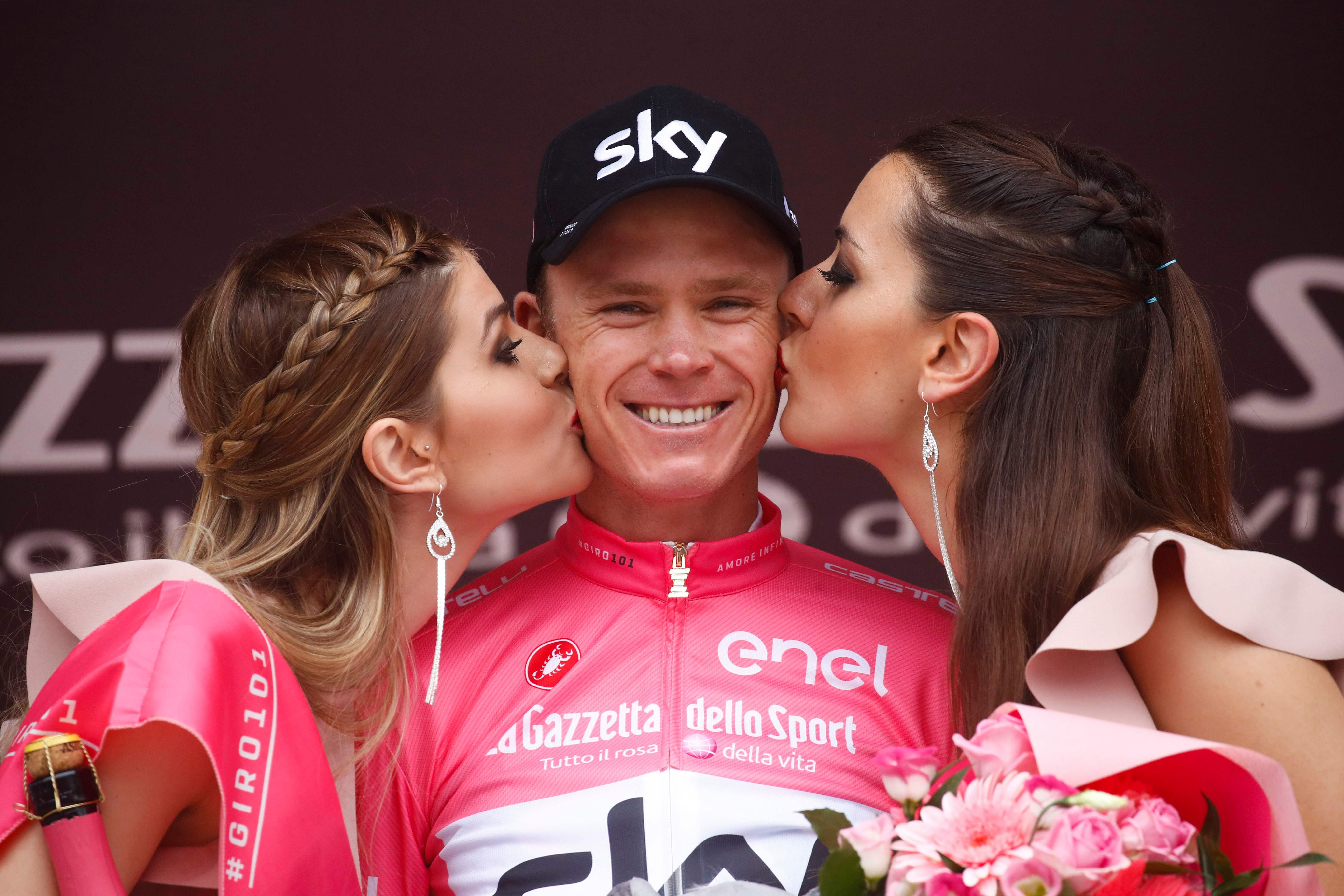 Froome celebrates holding on to the lead at the end of the penultimate stage in Italy