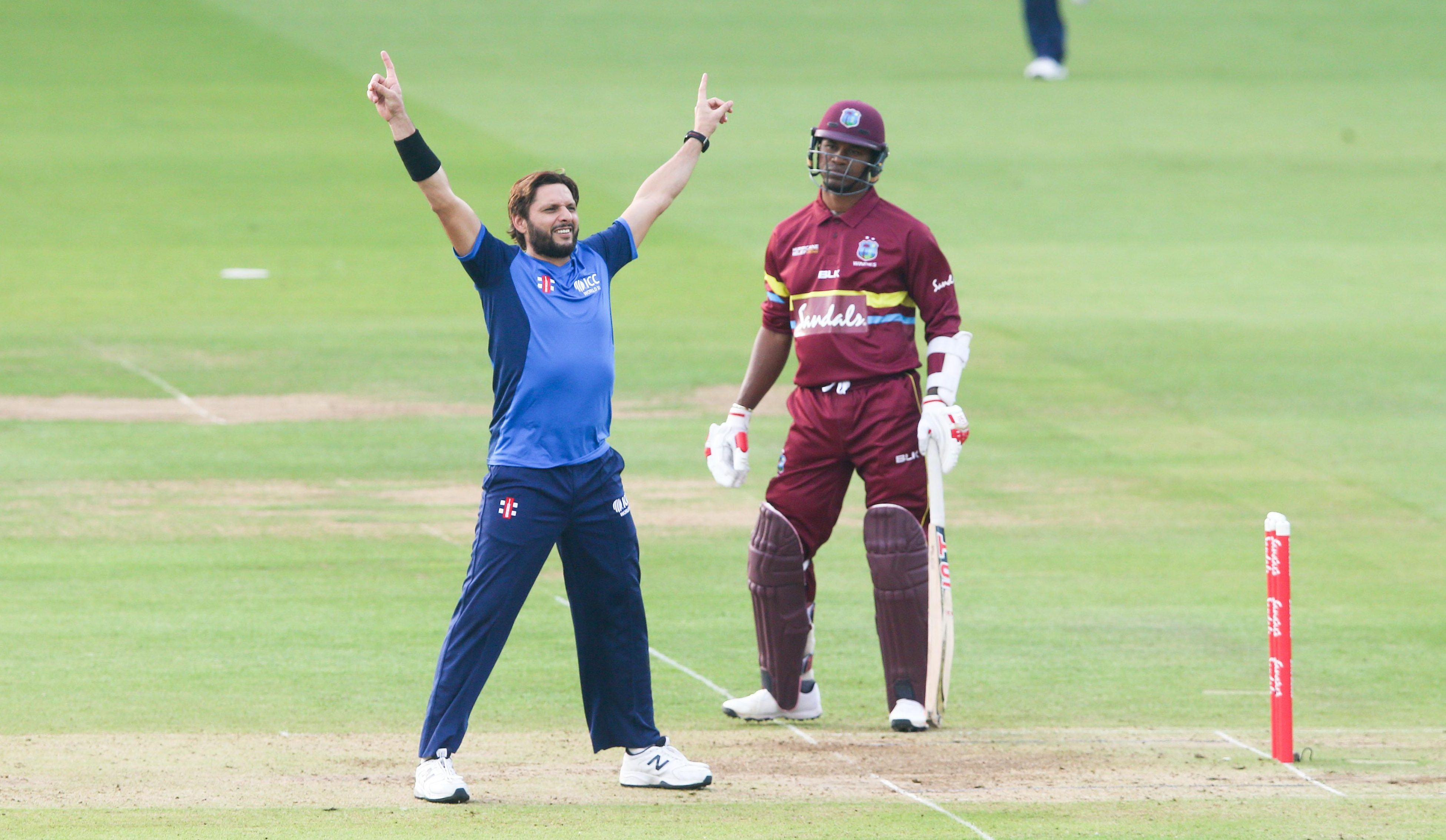 Pakistan legend Shahid Afridi celebrates a wicket for World XI in trademark fashion