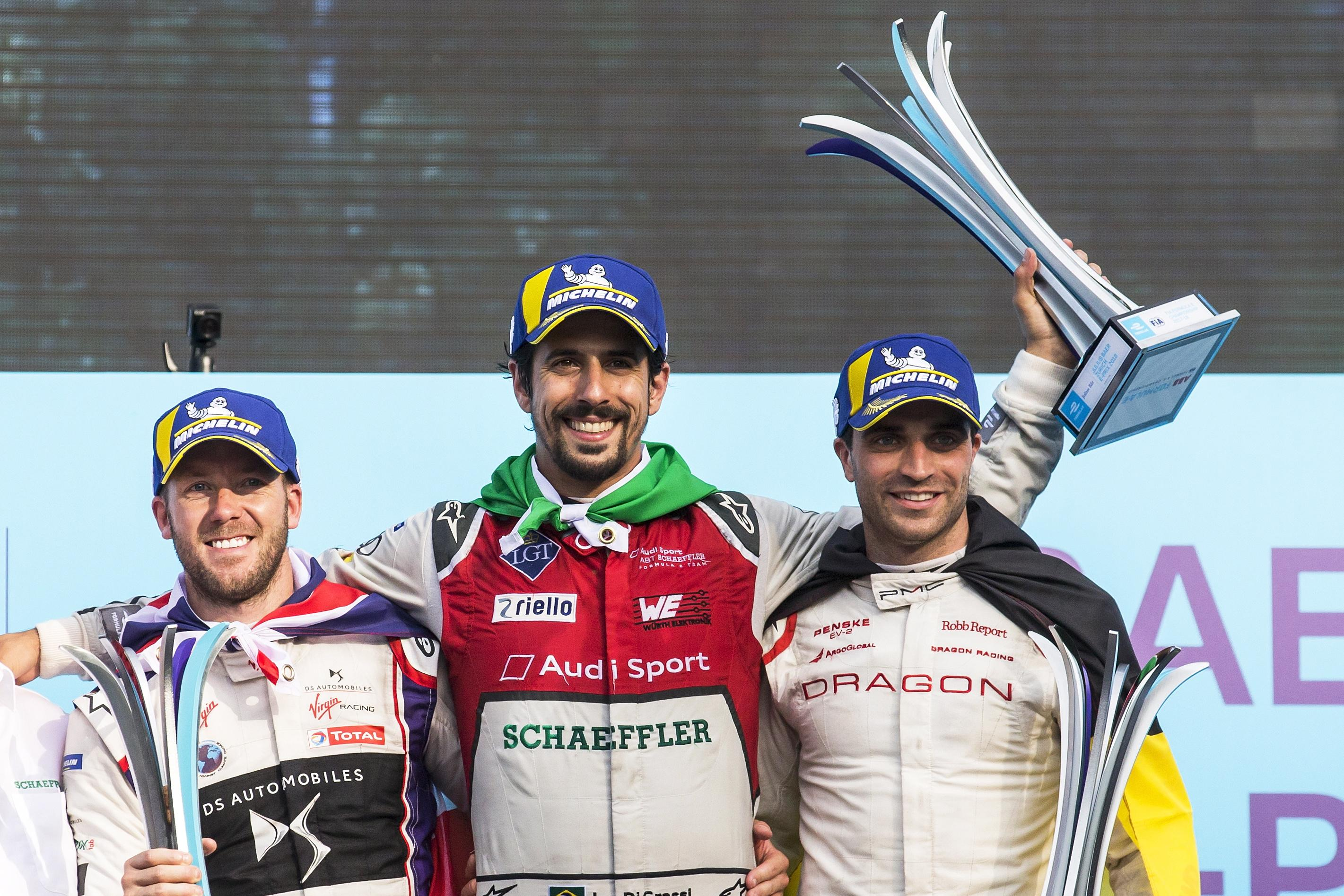 Sam Bird (left) finished second on the podium alongside Lucas Di Grassi (middle) and Jerome d'Ambrosio (right)