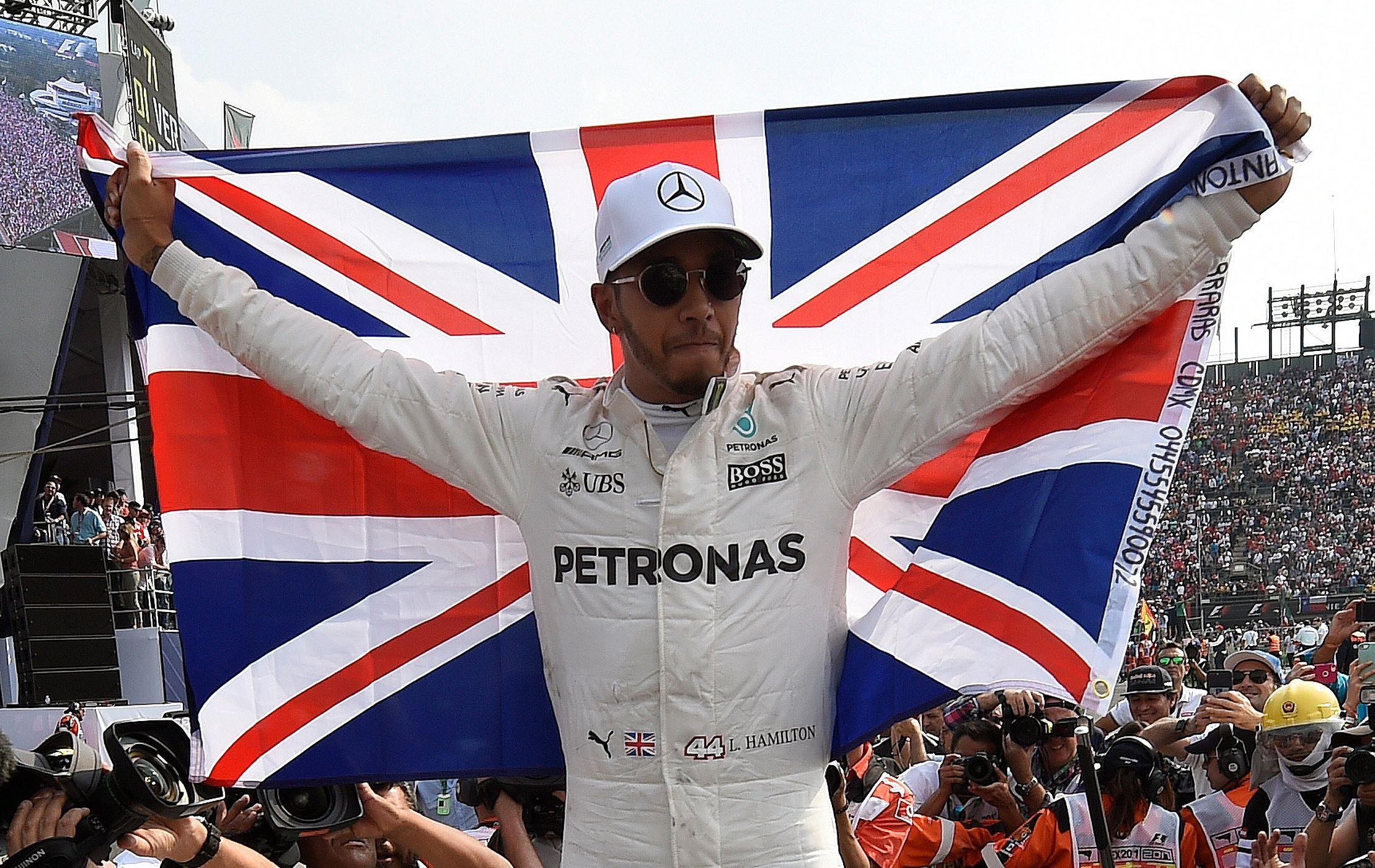 Lewis Hamilton celebrates as he wins his fourth world title at the Mexico Grand Prix last year