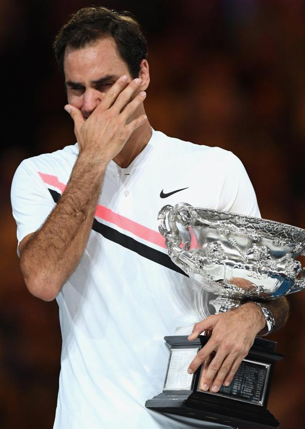 Roger Federer holds his trophy after the Australian Open final