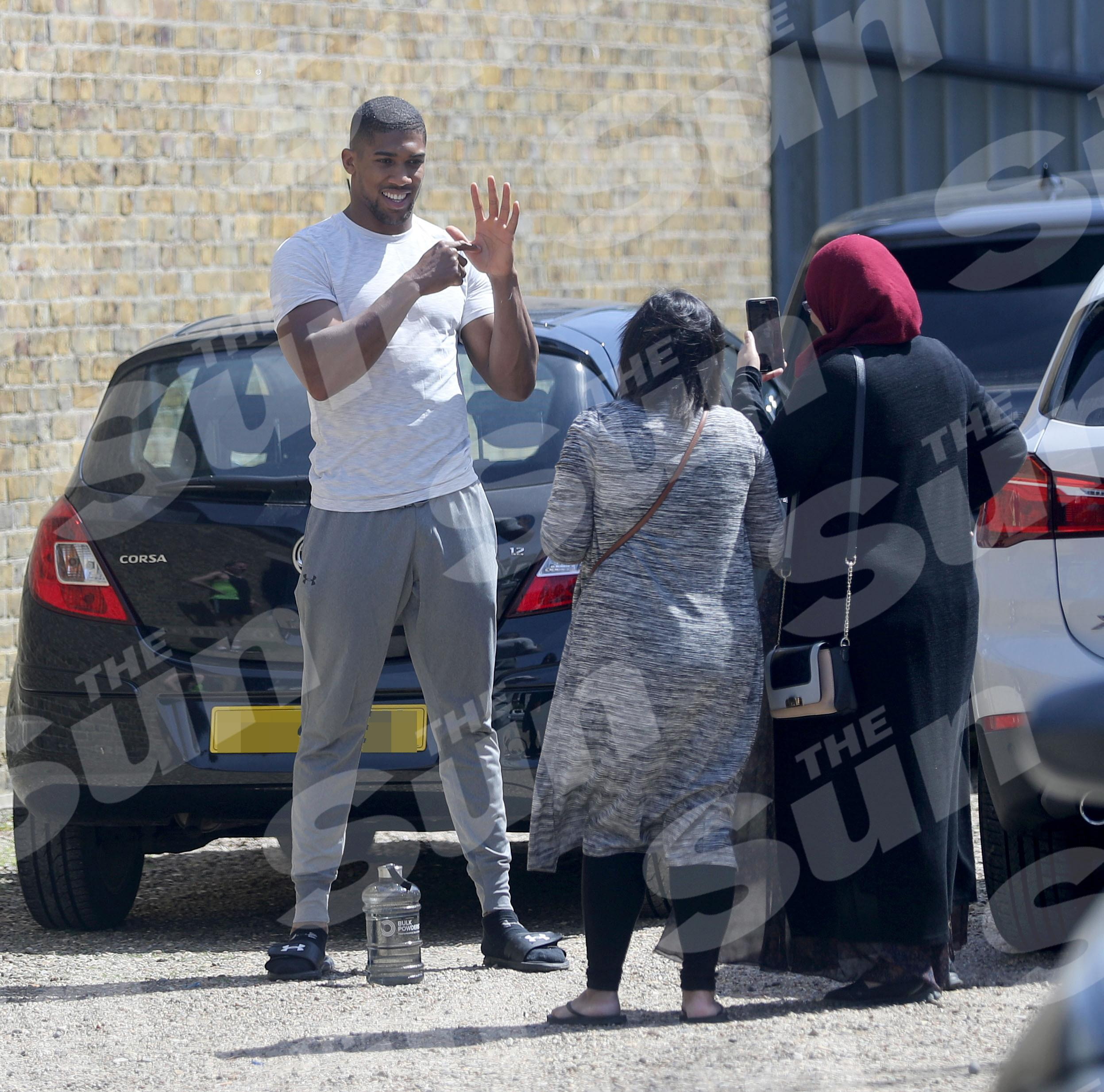SunSport's exclusive images show WBO, WBA and IBF heavyweight champ Anthony Joshua learning sign language from fans