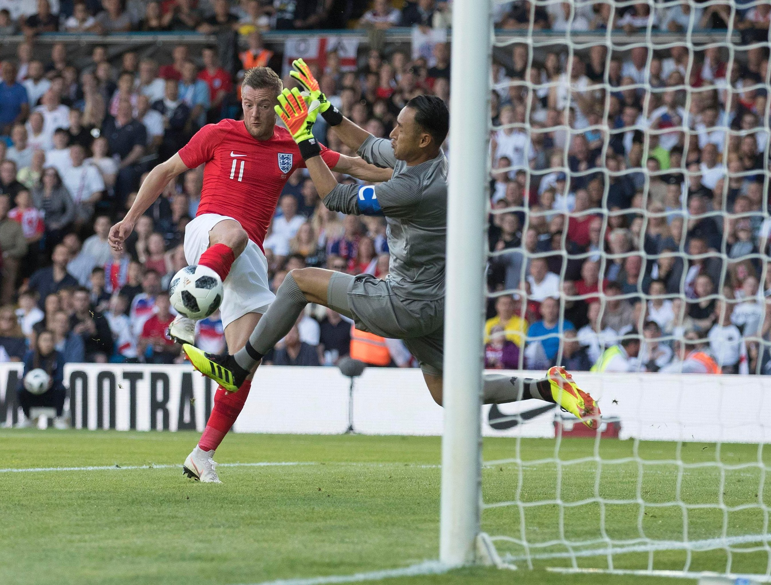 Keylor Navas makes a brave stop to deny Jamie Vardy from doubling the lead for England