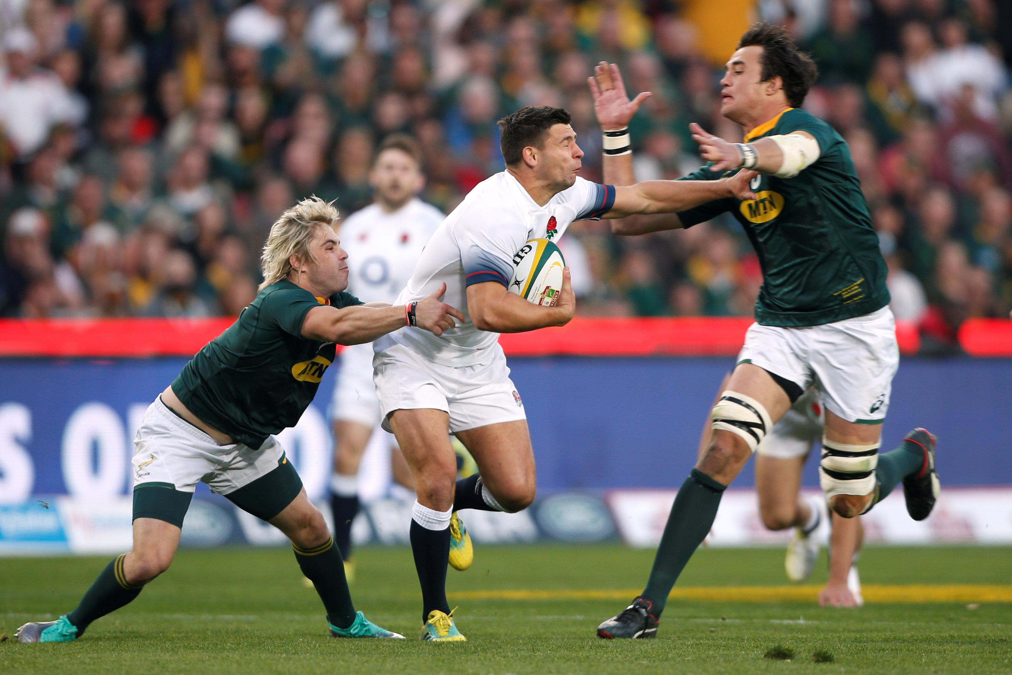 England's Ben Youngs in action with South African star Franco Mostert