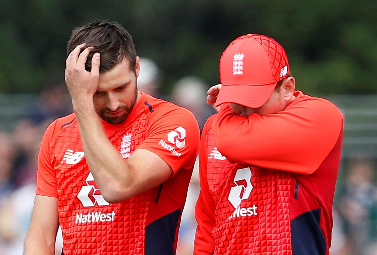 Eoin Morgan and Mark Wood look dejected after the defeat in Edinburgh