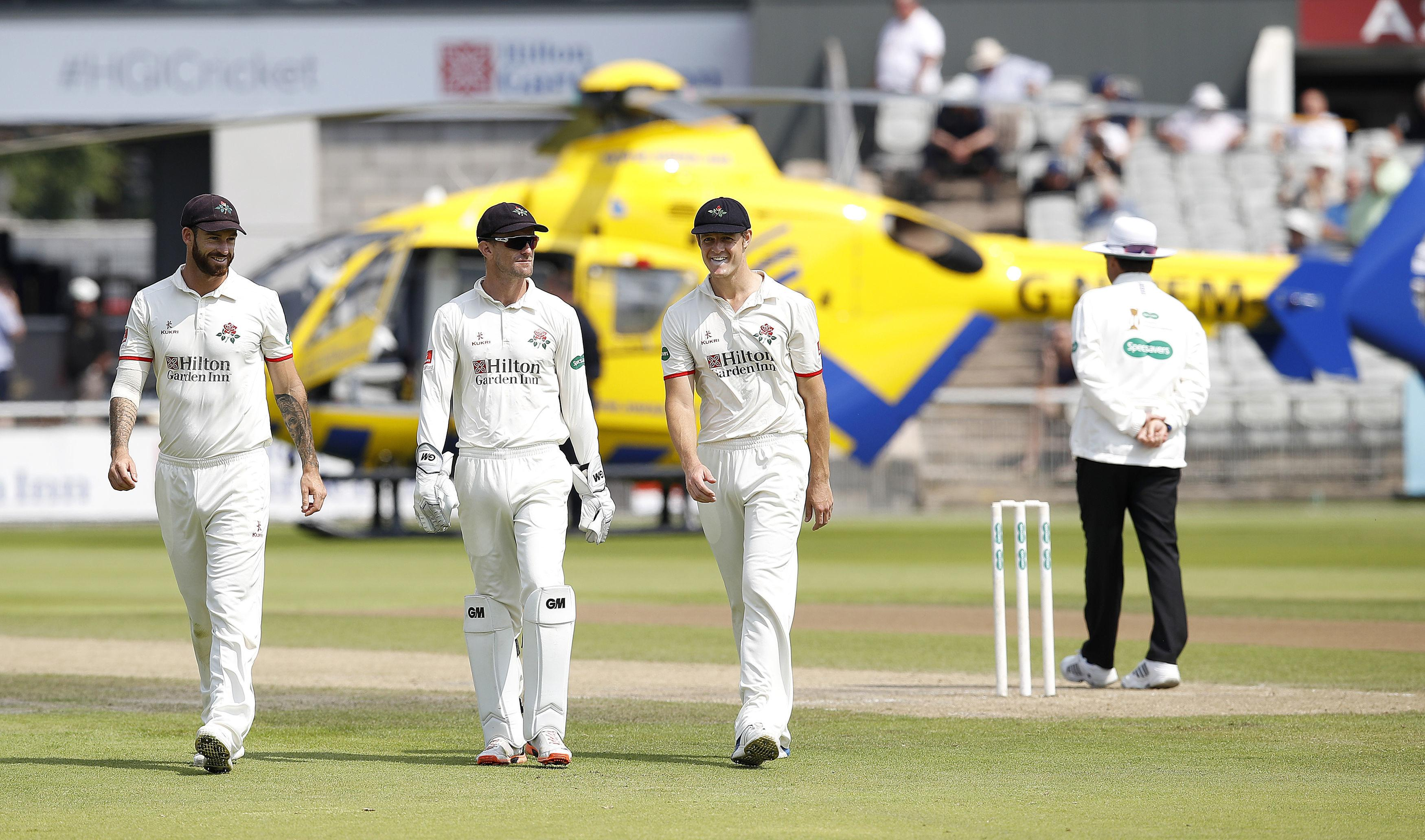 Players were forced to leave the pitch as the air ambulance arrived