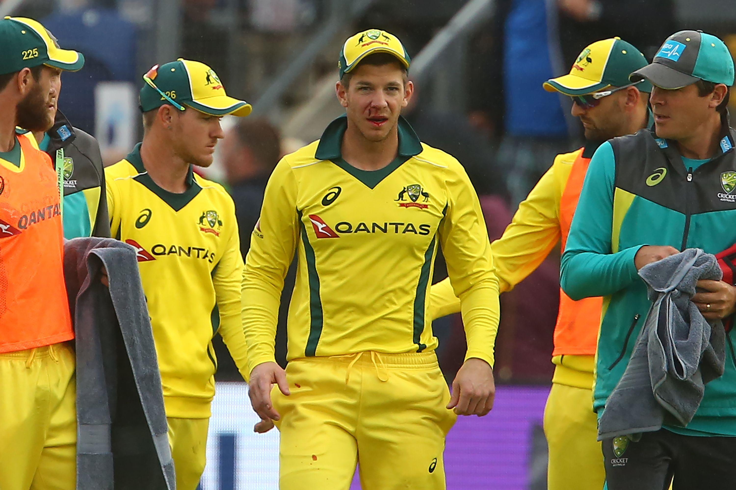 Tim Paine looked worse for wear after being whacked in the face