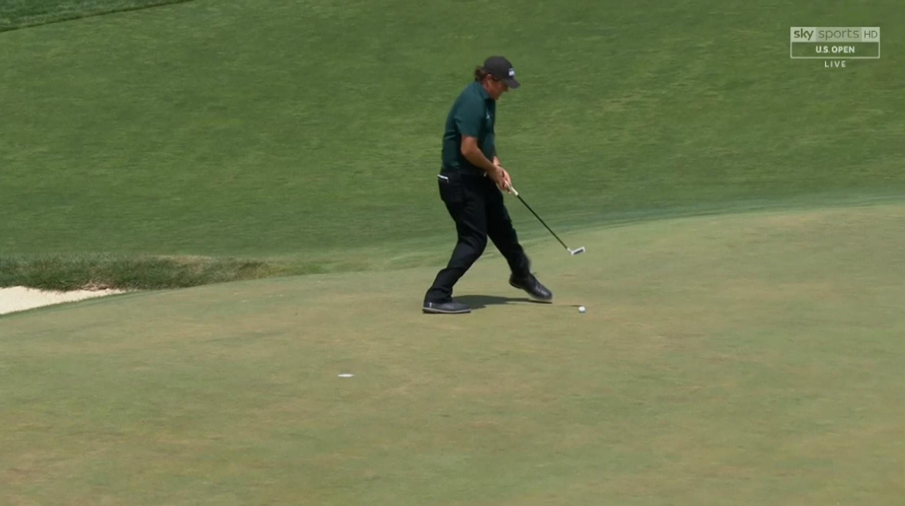 Phil Mickelson hit a moving ball on day three to earn a two-stroke penalty
