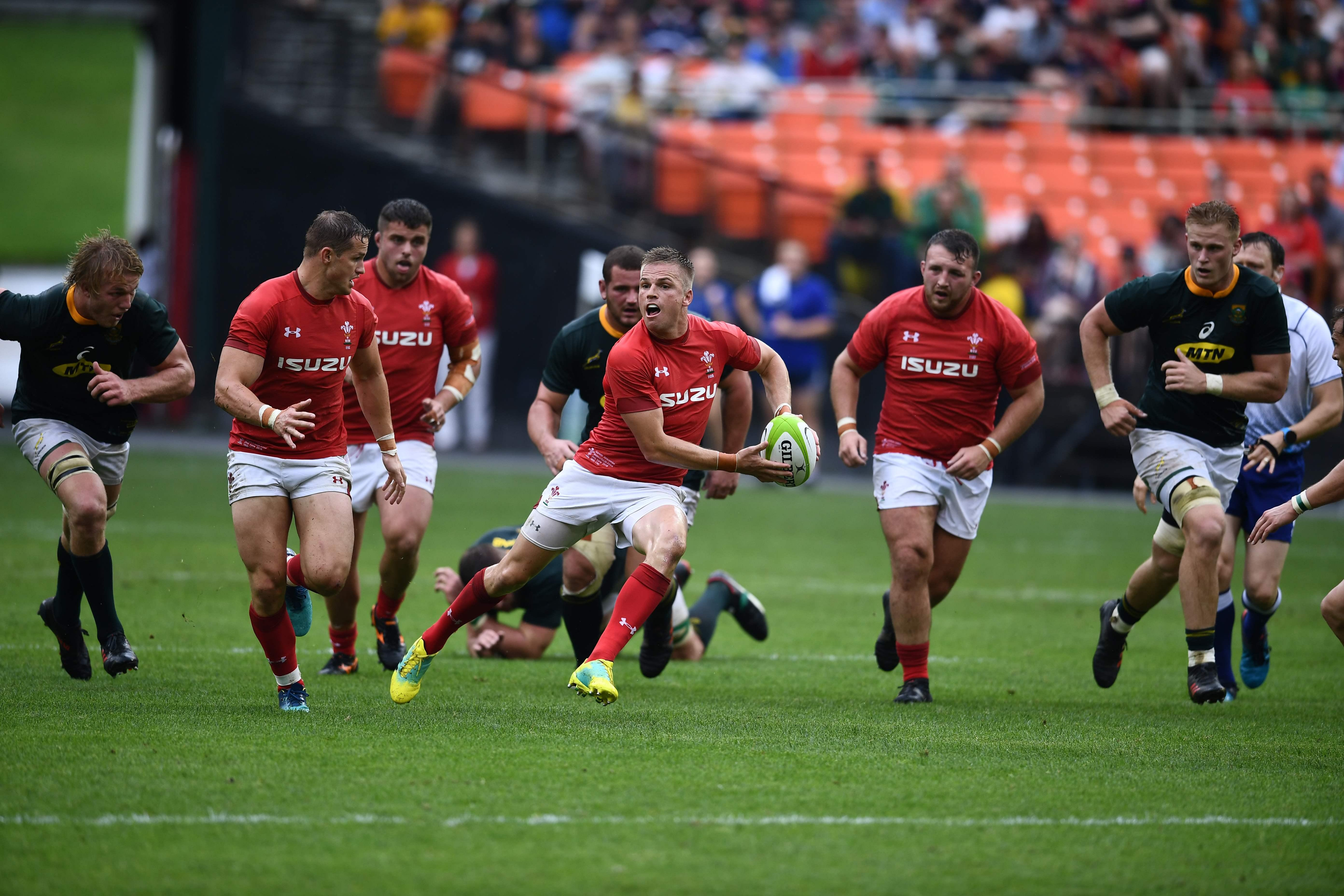 Anscombe runs with the ball during the build-up to Wales' first try