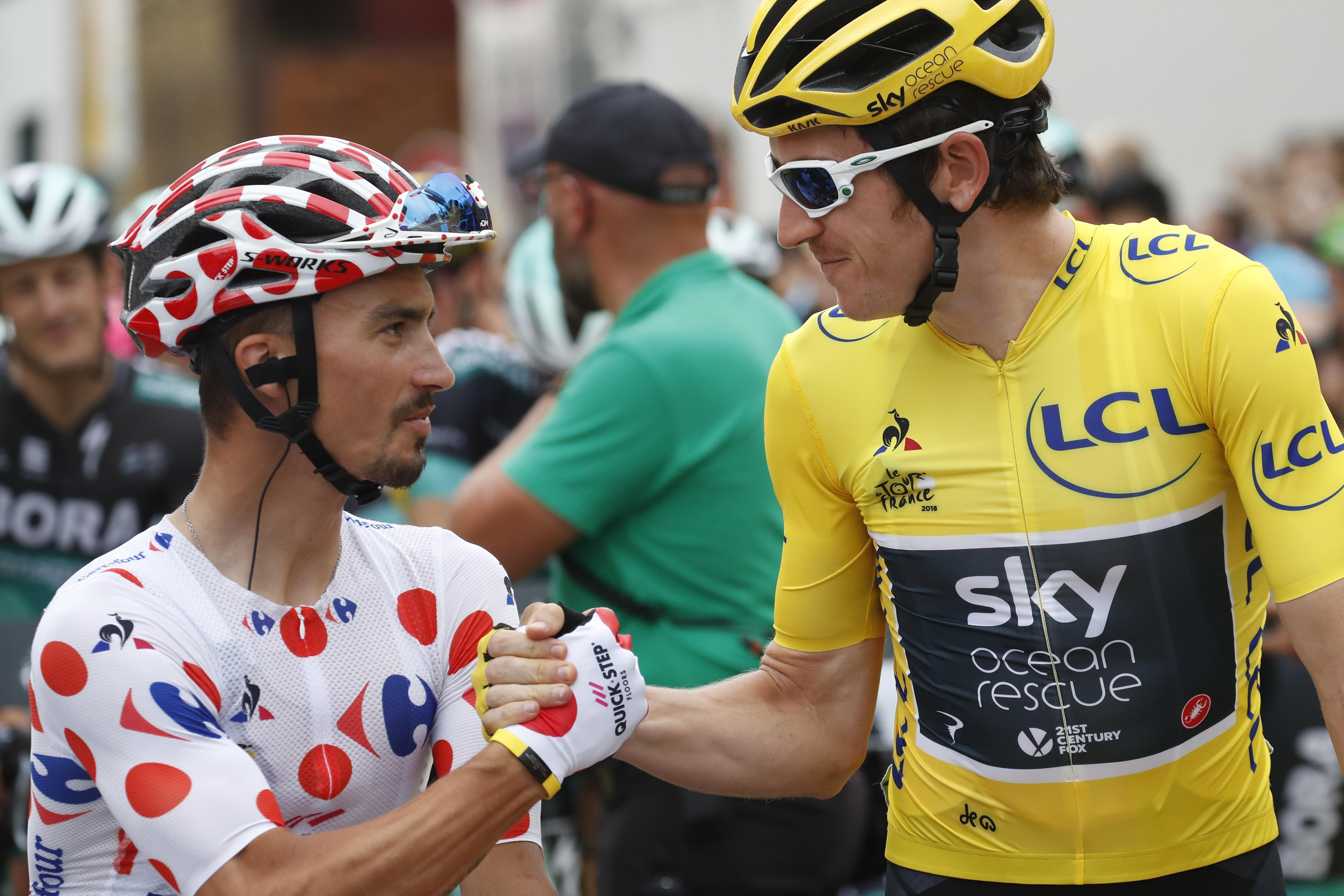 Julian Alaphilippe in the polka-dot climber's jersey shakes hands with 2018 champ Thomas