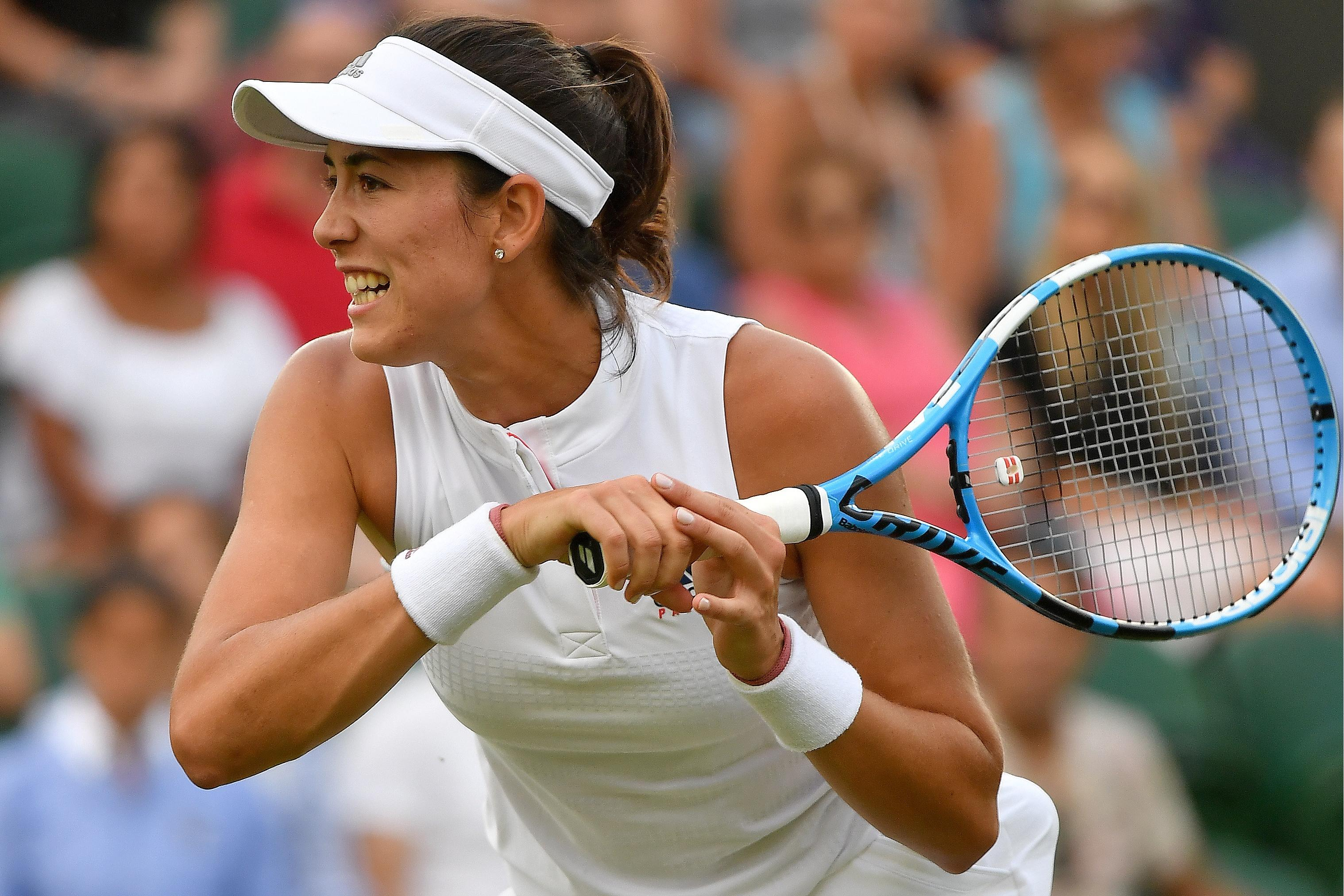 Garbine Muguruza crashed out in what is the biggest shock of this year's tournament