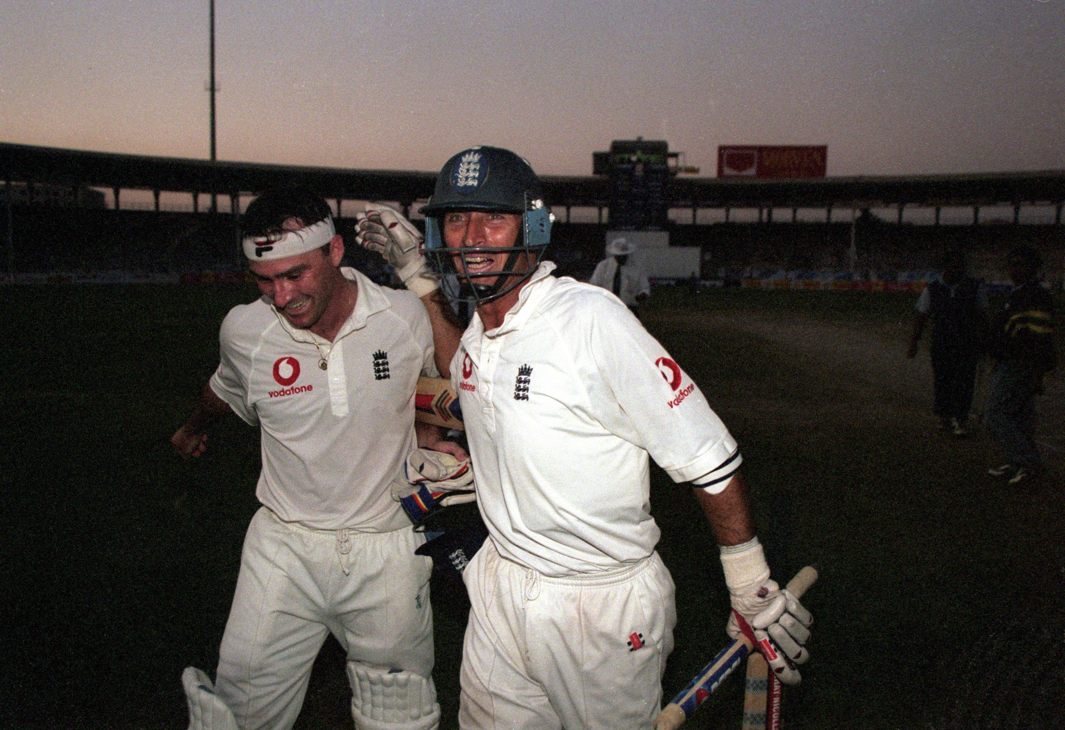 Graham Thorpe, left, and Nasser Hussain celebrate their victory