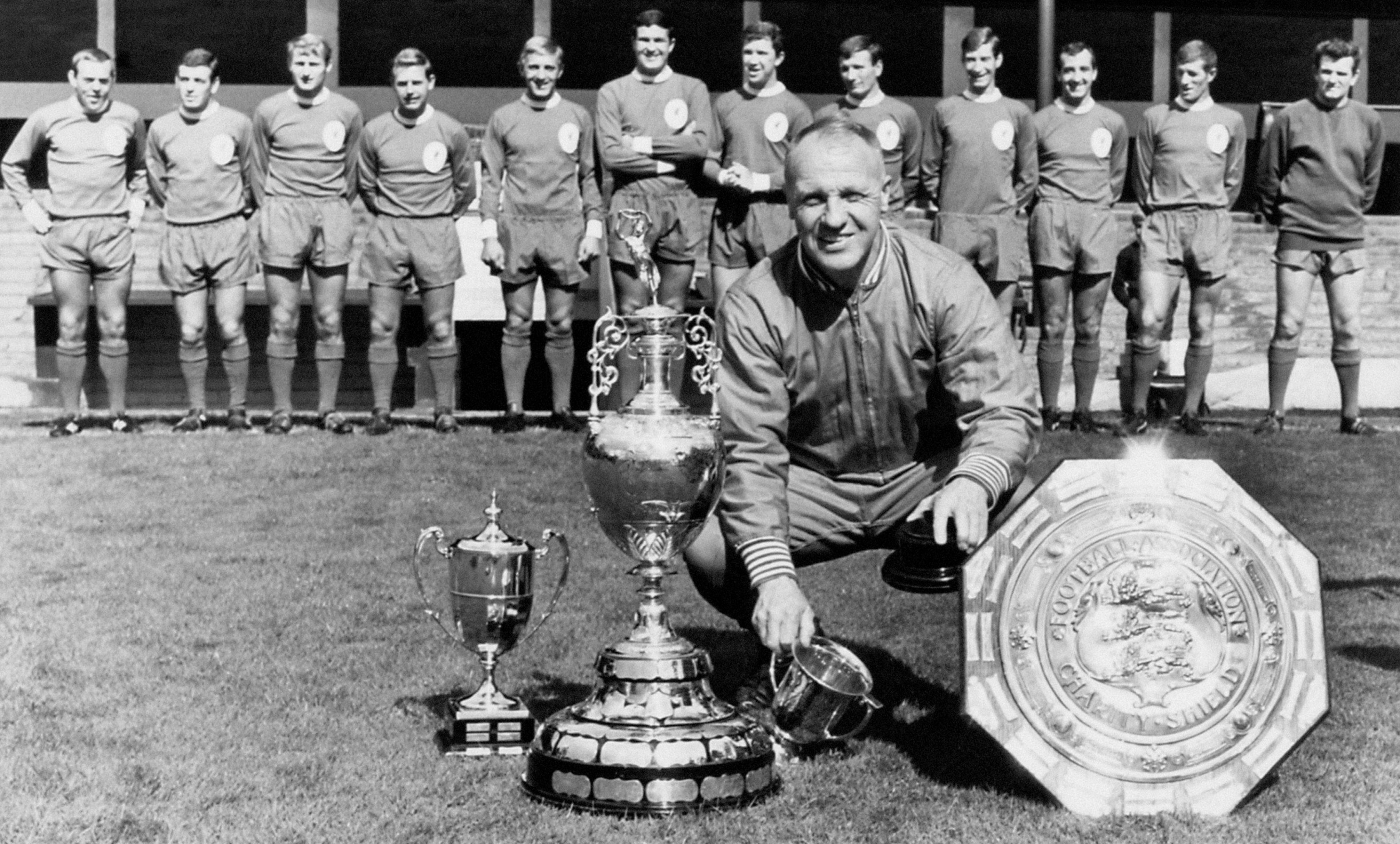 Bill Shankly shows off his Liverpool trophy haul