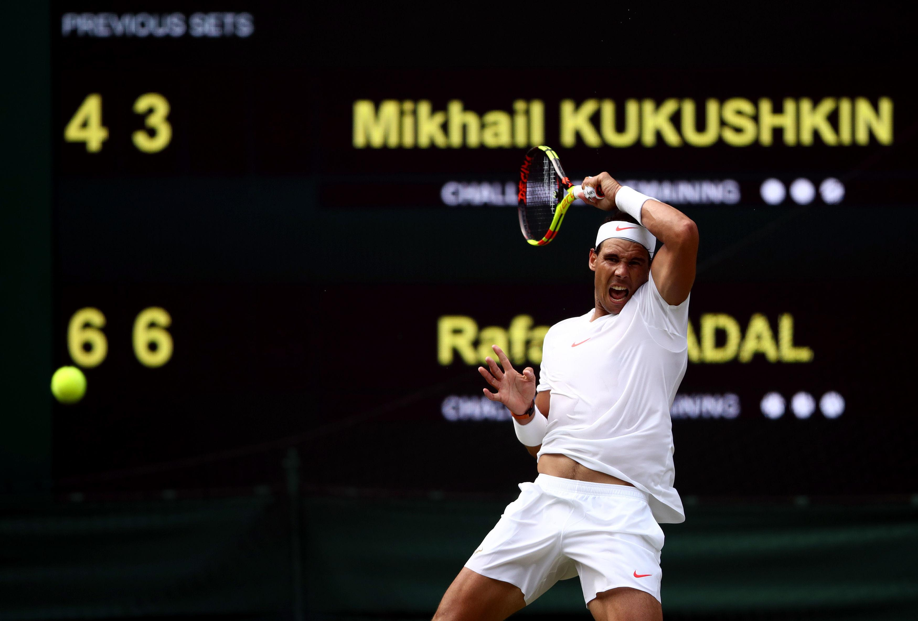 Nadal lets rip with a fearsome forehand as he cruised to a straight sets win on Centre Court