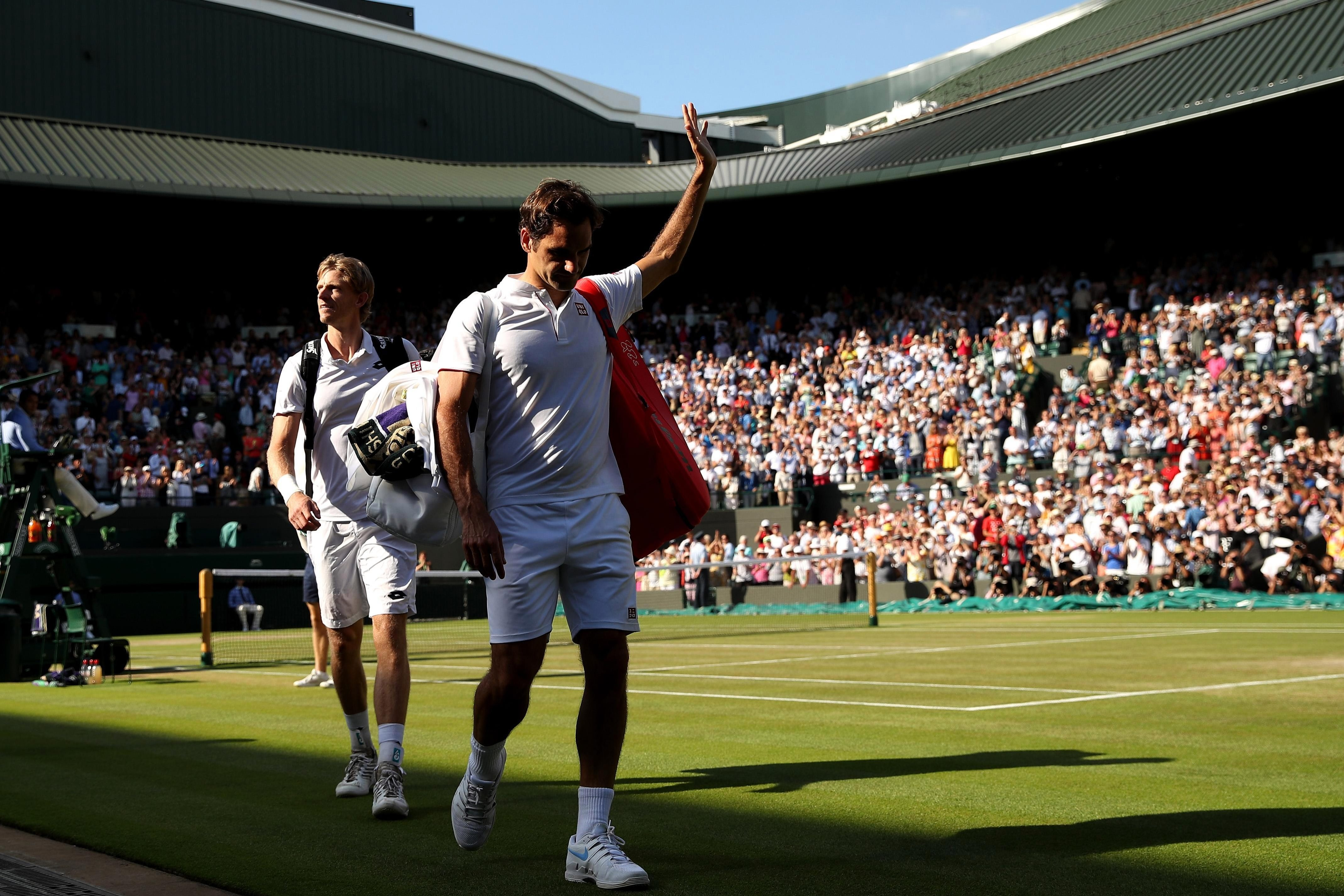 Federer applauds his adoring fans as he departs Court One after crashing out at the All England Club
