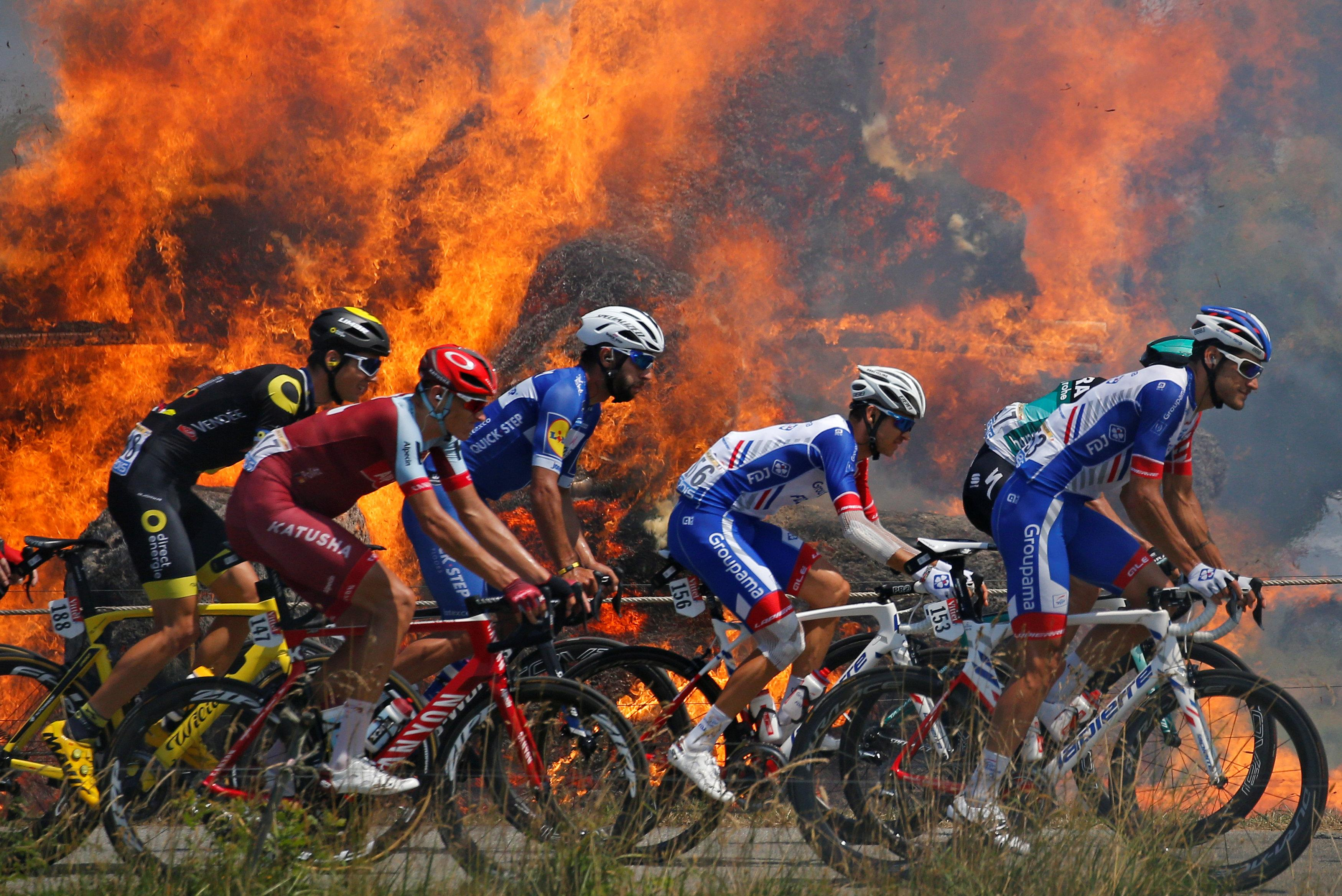 Tour de France riders cruised past a massive fire as bails of hay were set alight in Brittany