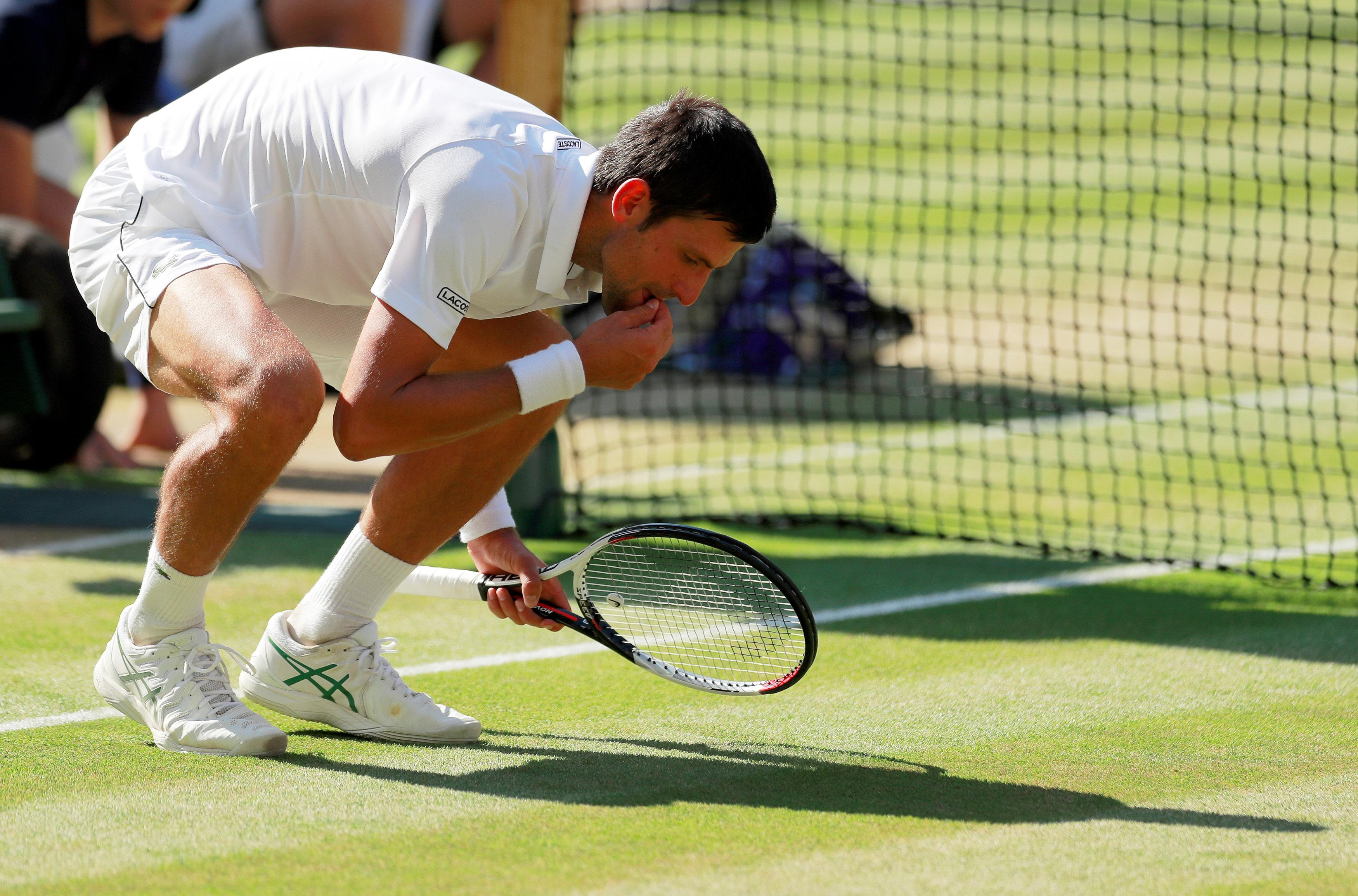 As is his tradition, Djokovic ate some of the Wimbledon grass