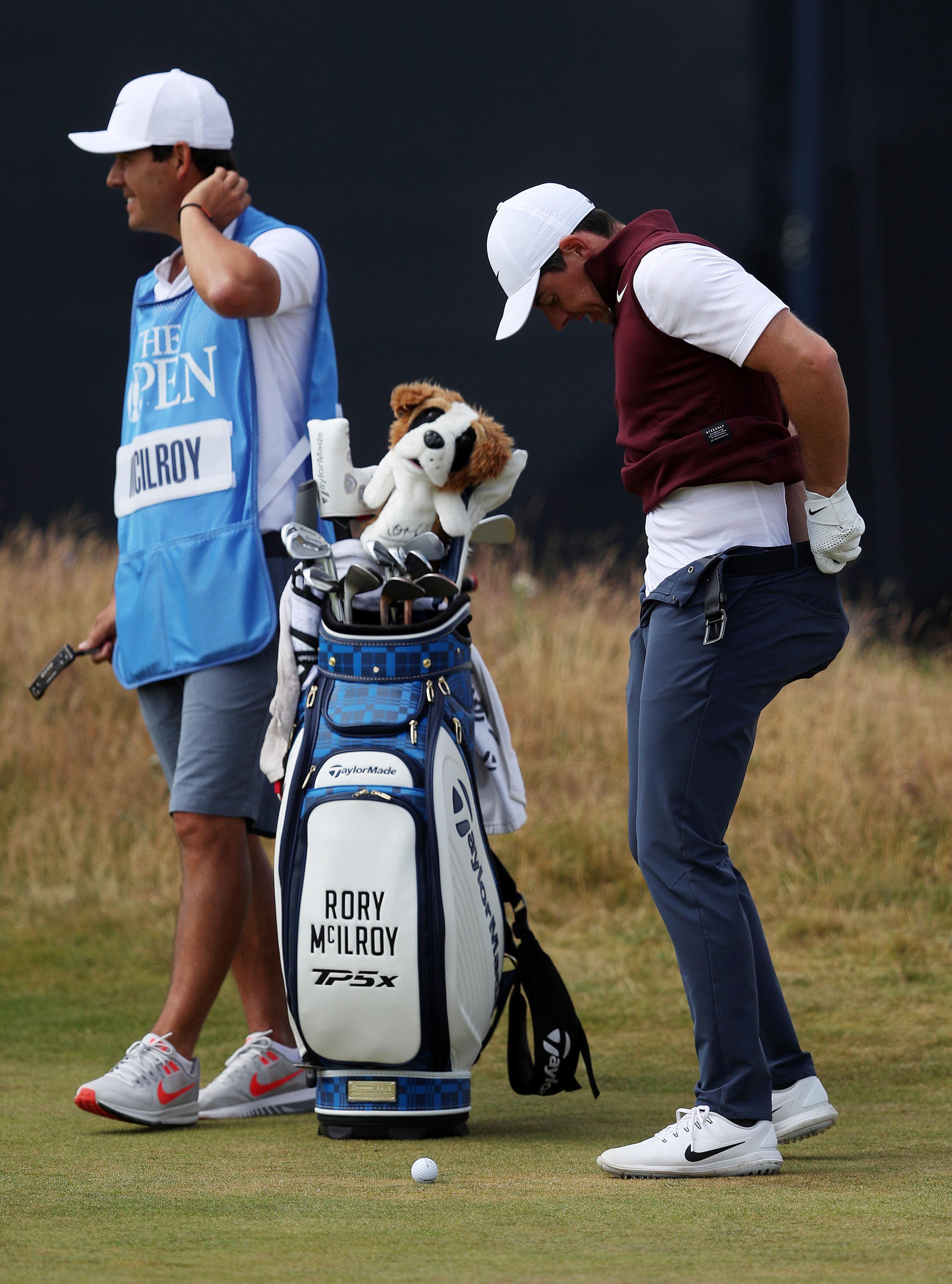 But while he looked for his ball on the floor, Rory McIlroy decided he would check out his attire