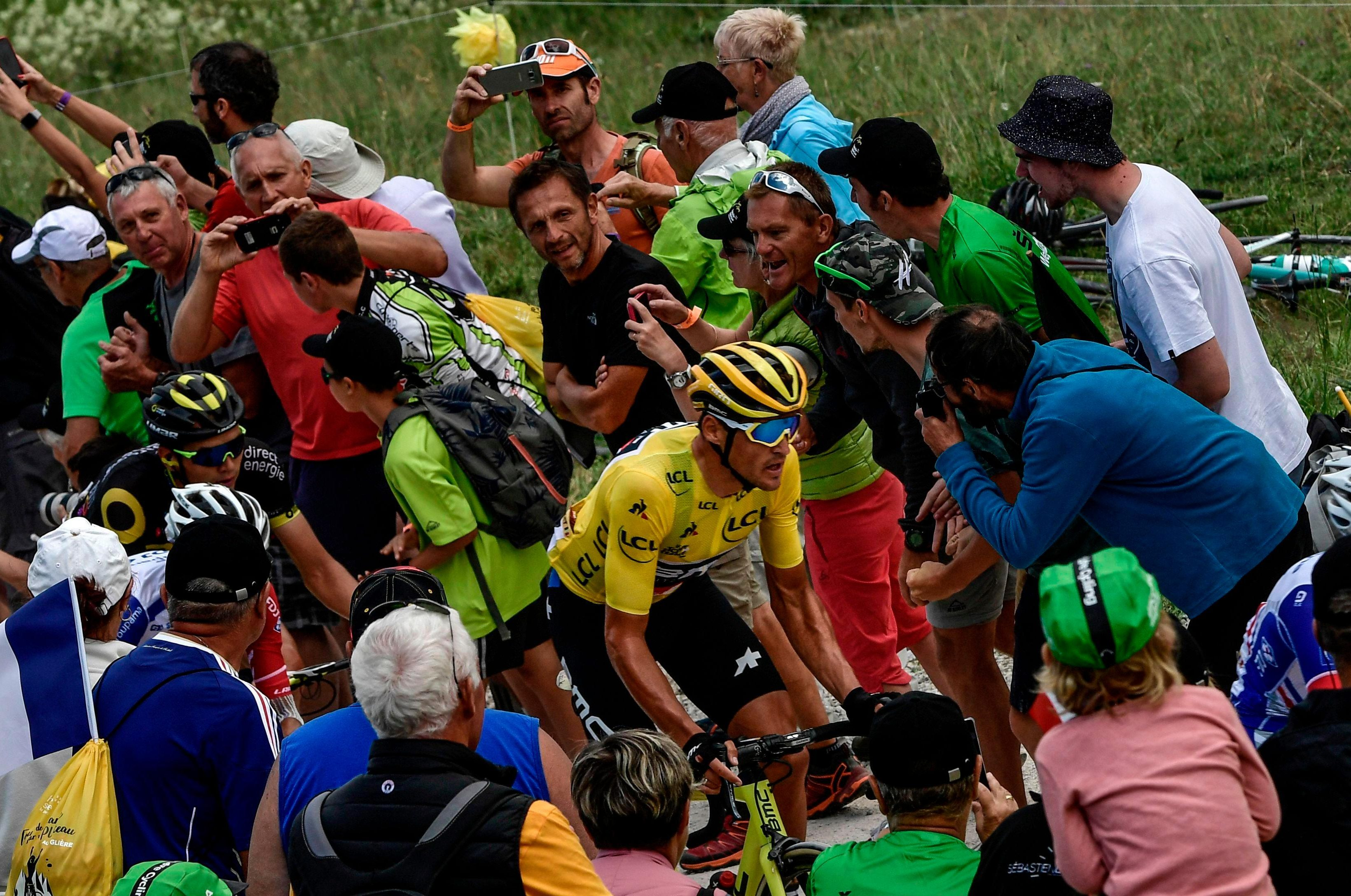 Another dramatic example of closeness of riders and fans as Belgium's Greg Van Avermaet, centre climbs the Plateau des Glieres ascent on the tenth stage