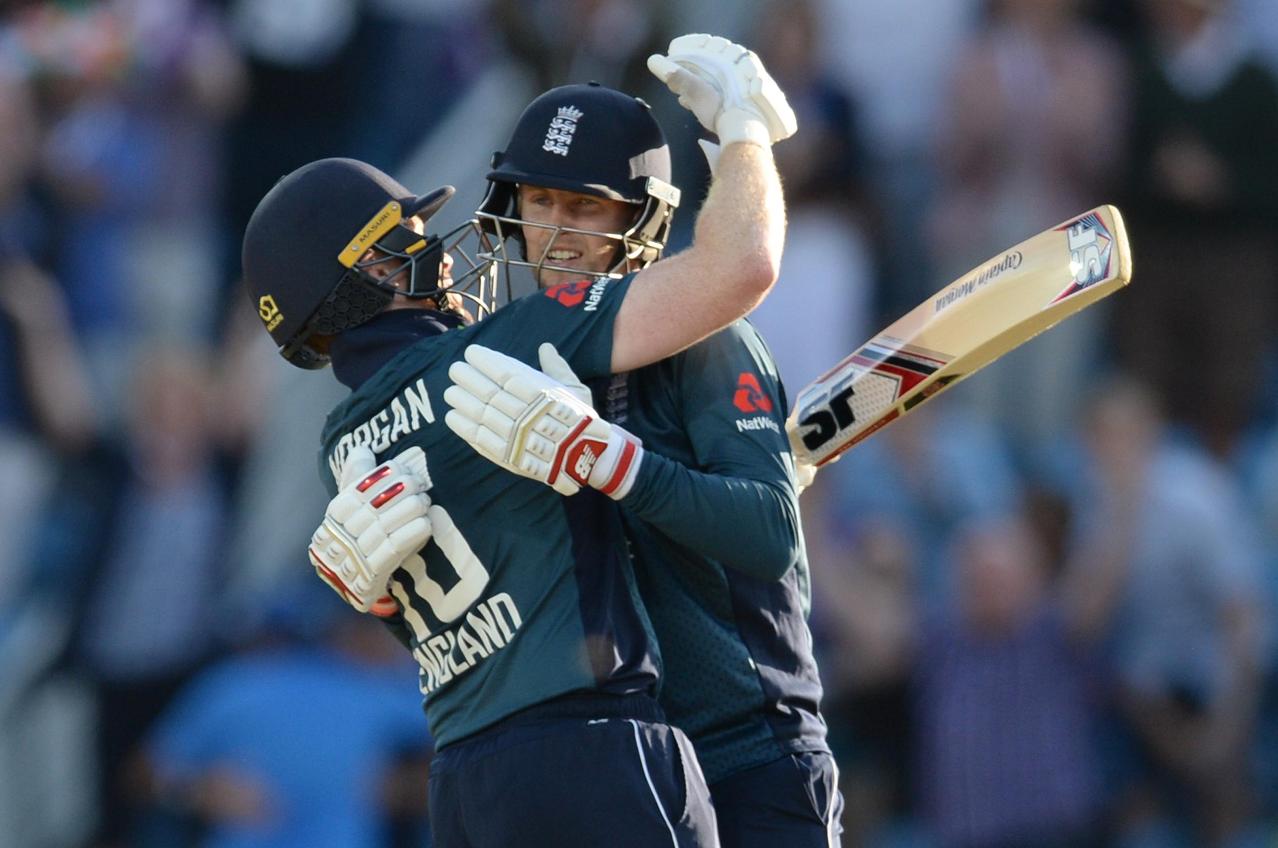 Root and Morgan embrace after guiding England to a series win