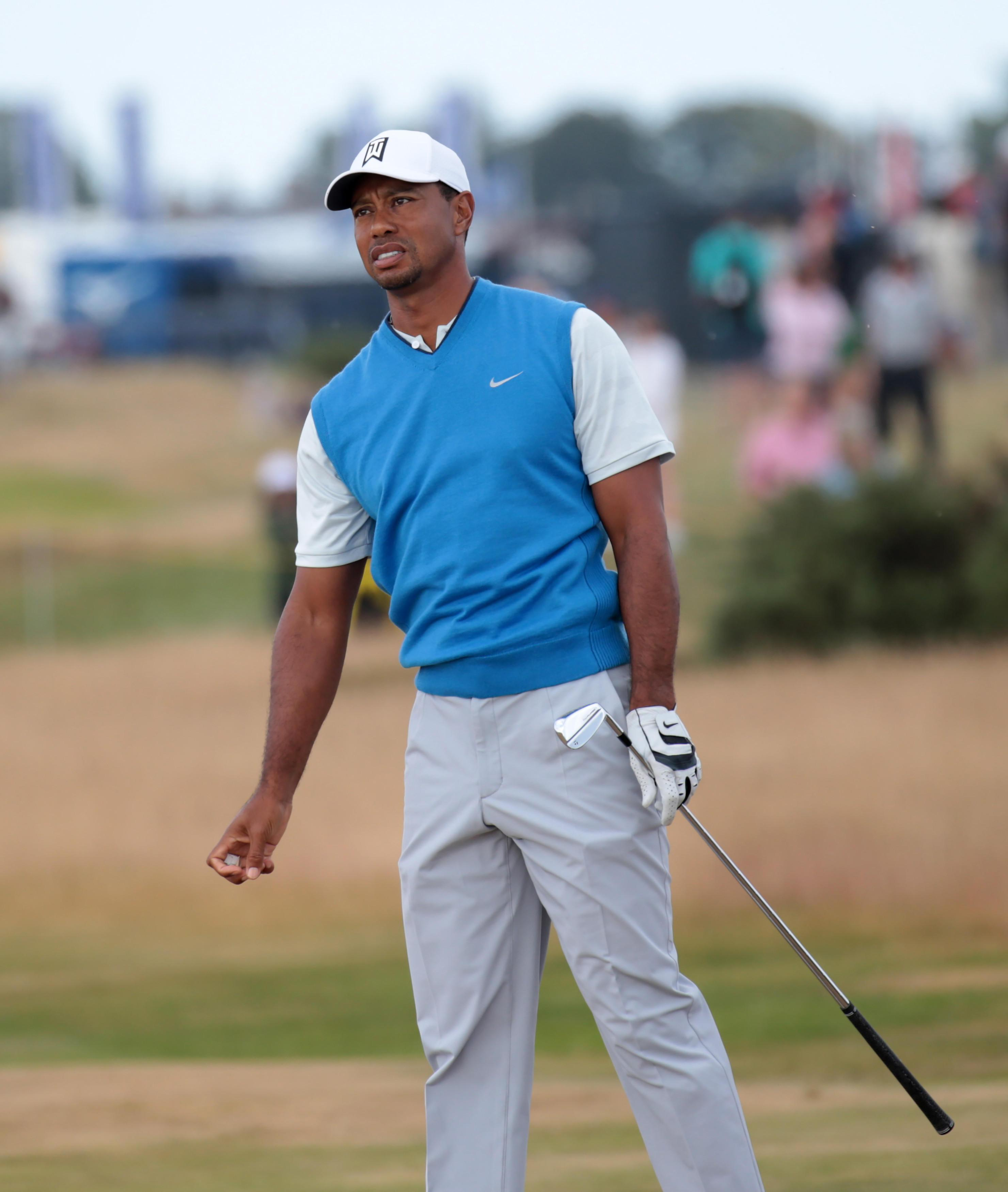 Tiger Woods is laying chase to Open leader Kevin Kisner