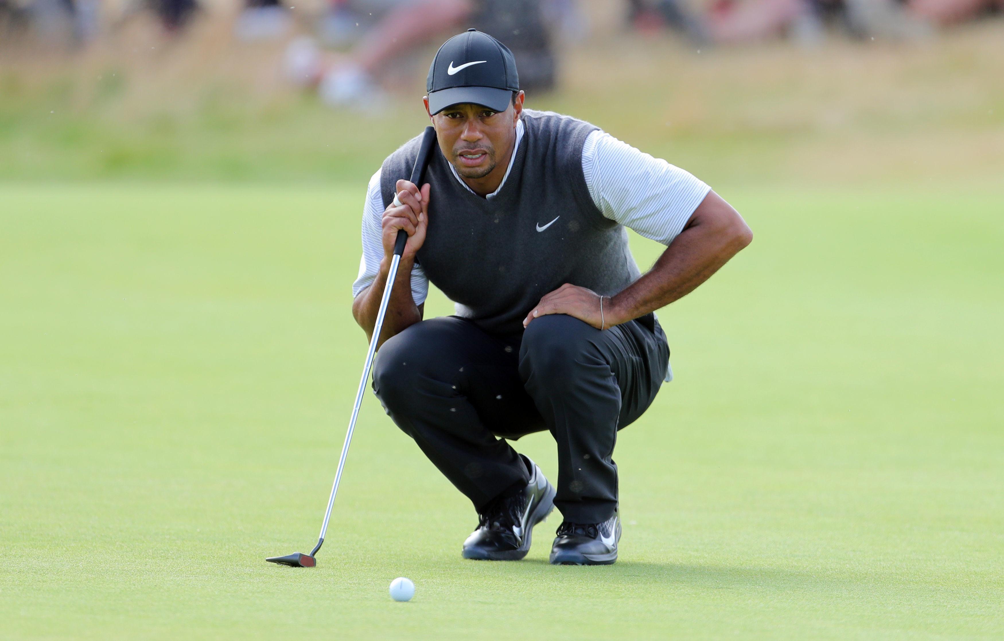 Tiger Woods studies a putt during his third round five-under 66